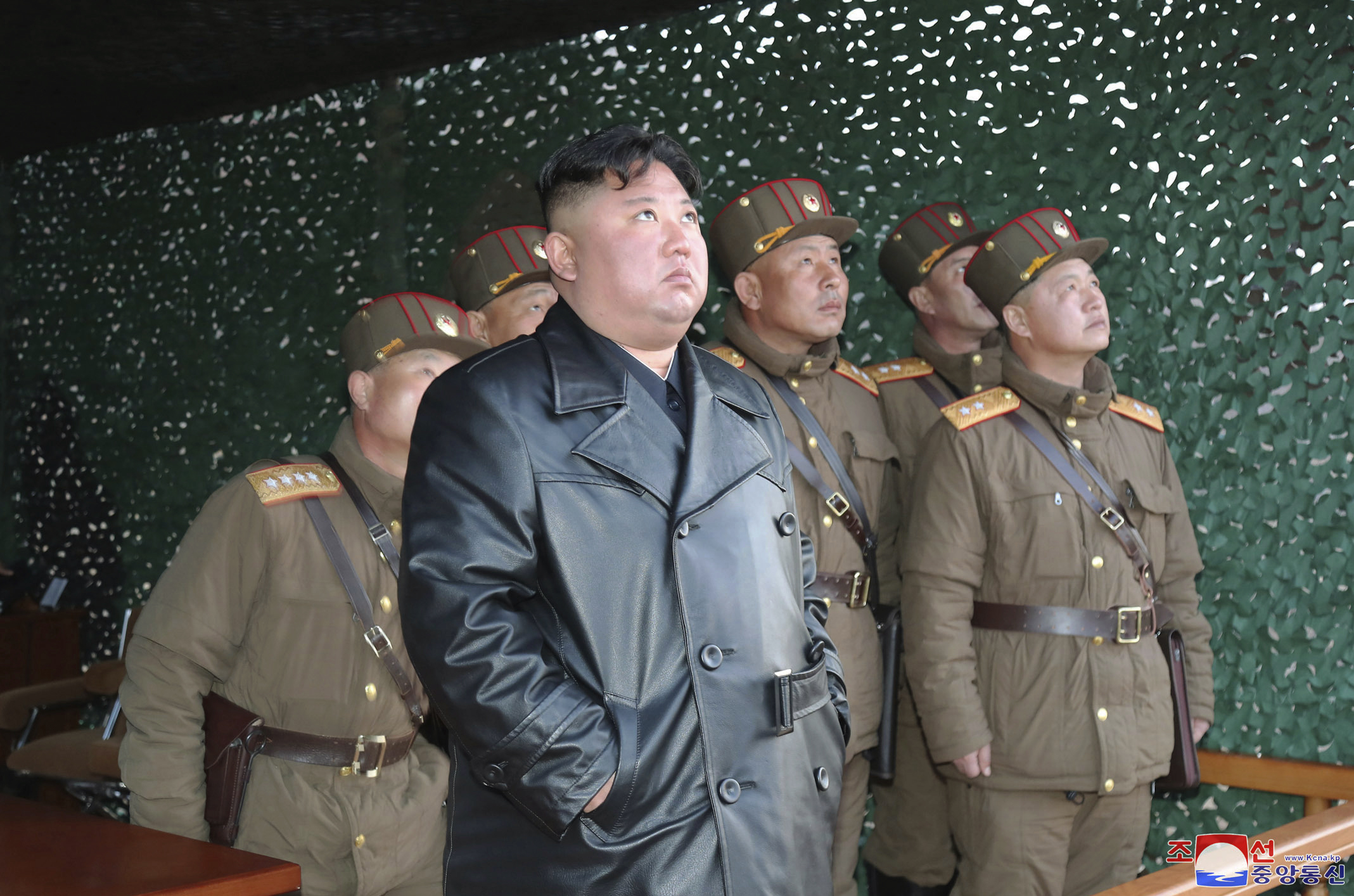 In this photo provided by the North Korean government, North Korean leader Kim Jong Un inspects military exercise at an undisclosed location in North Korea on March 21, 2020.
