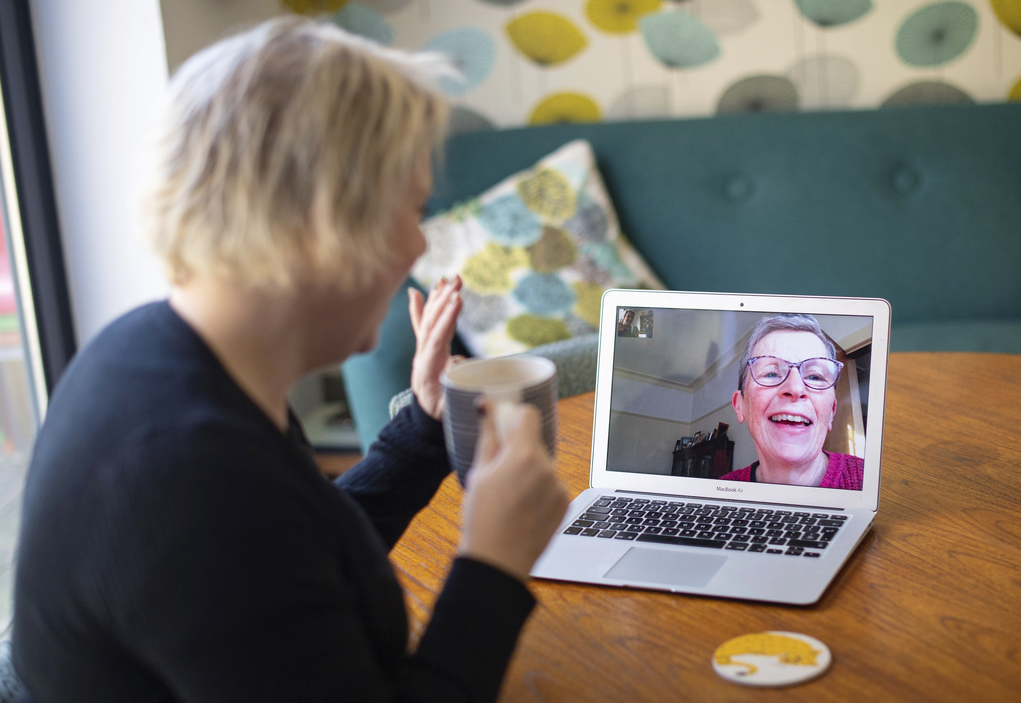 Helen Walters, left, talks to her mother Gillian using video calling, as people find alternative ways to celebrate Mother's Day to limit the potential spread of COVID-19 coronavirus, in London, on March 22, 2020.
