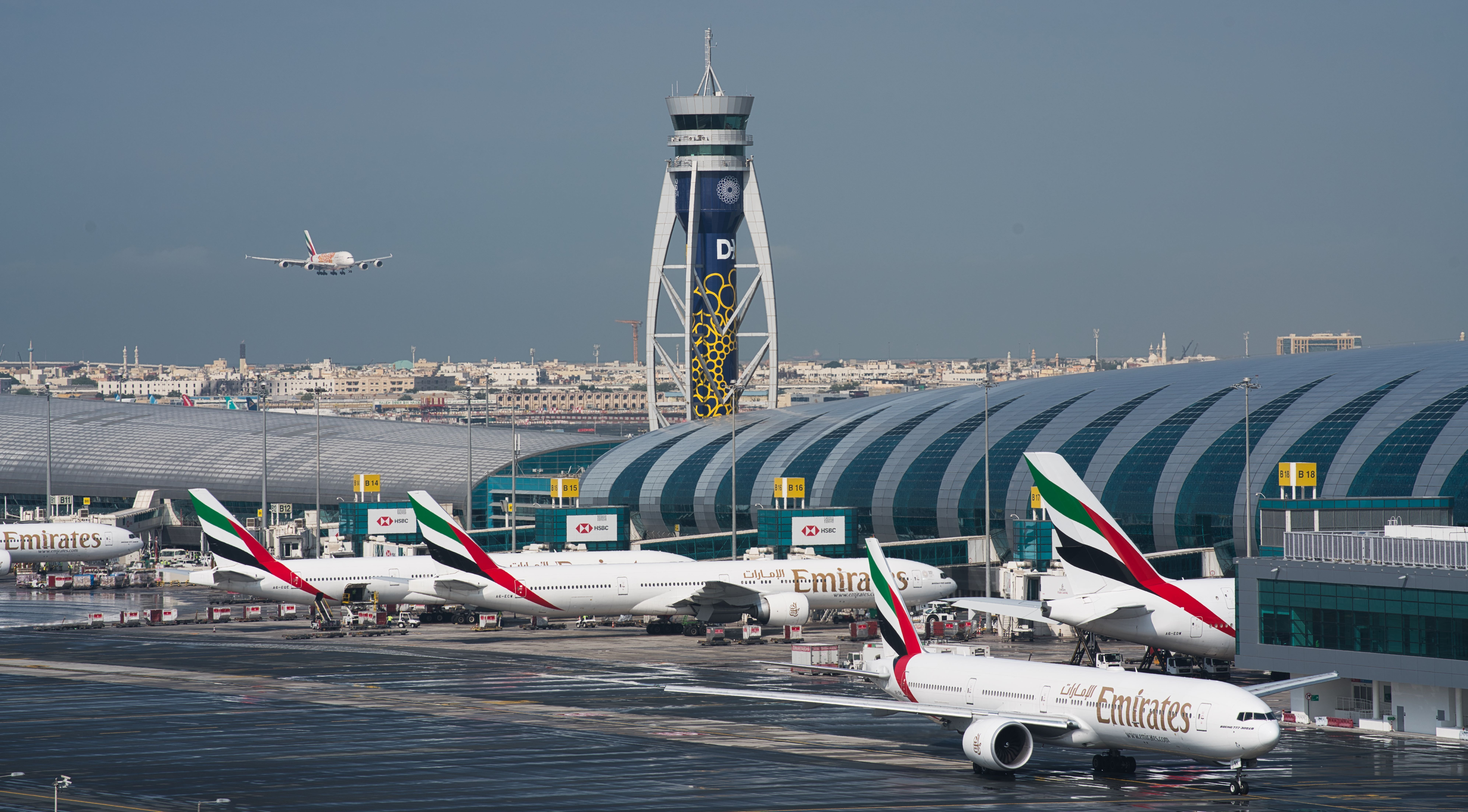 An Emirates jetliner comes in for landing at Dubai International Airport in Dubai, United Arab Emirates, on Dec. 11, 2019.