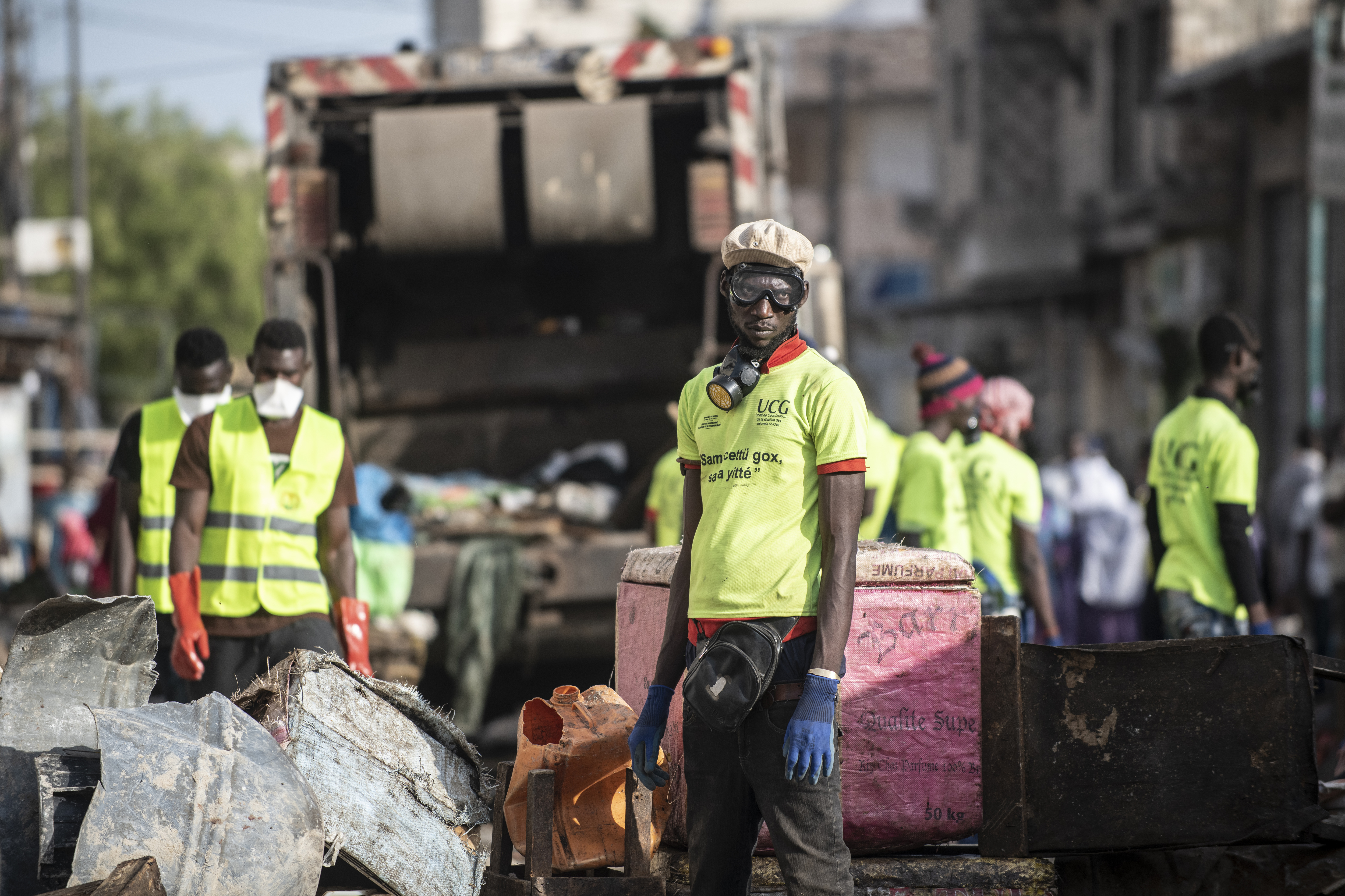 Municipal workers block streets as a bulldozer demolishes informal shops in an effort to stop the spread of the coronavirus in Dakar's popular Medina's neighborhood on March 22, 2020.