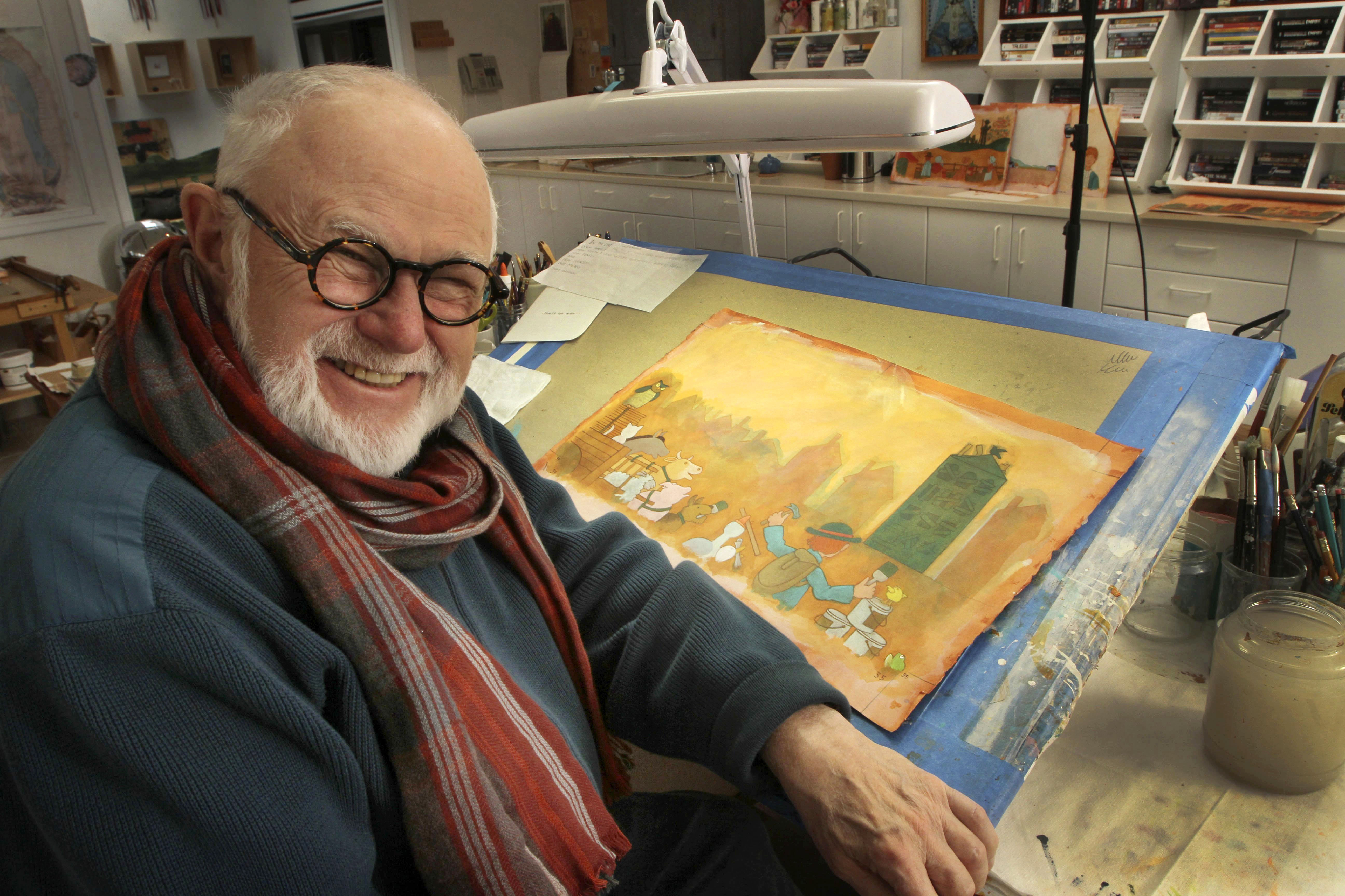 Tomie dePaola poses with his artwork in his studio in New London, N.H., on Dec. 1, 2013.