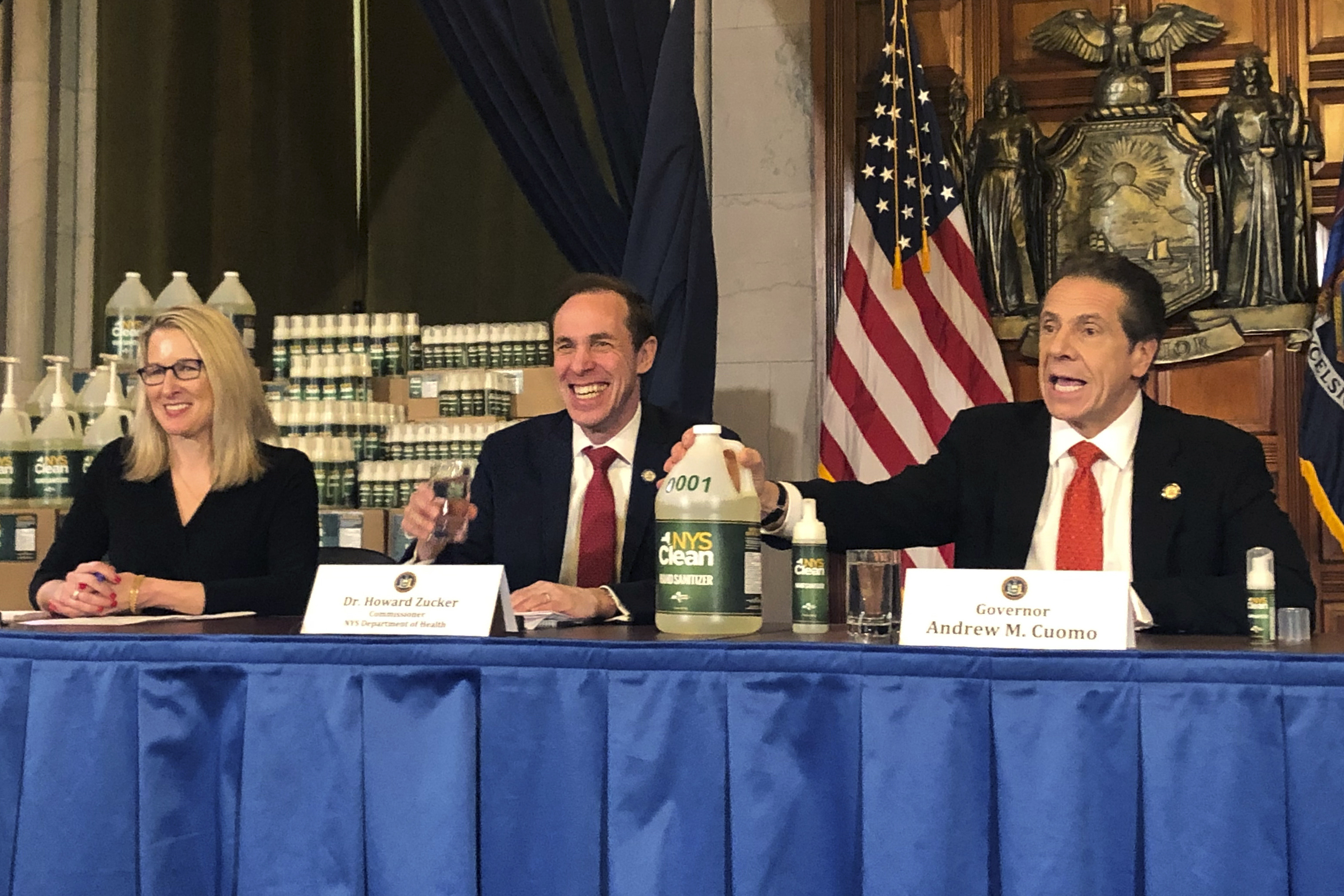 New York Gov. Andrew Cuomo, right, introduces  New York State Clean,  a hand sanitizer manufactured by the state of New York in response to shortages of the alcohol- based substance, during a news conference update on the coronavirus, Monday, March 9, 2020, in Albany, N.Y.