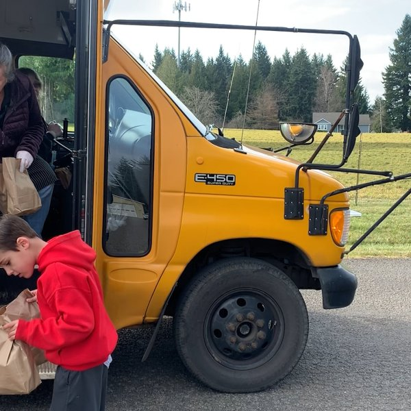 Staff members of Oregon's Estacada School District drop off lunches to students on March 18, 2020