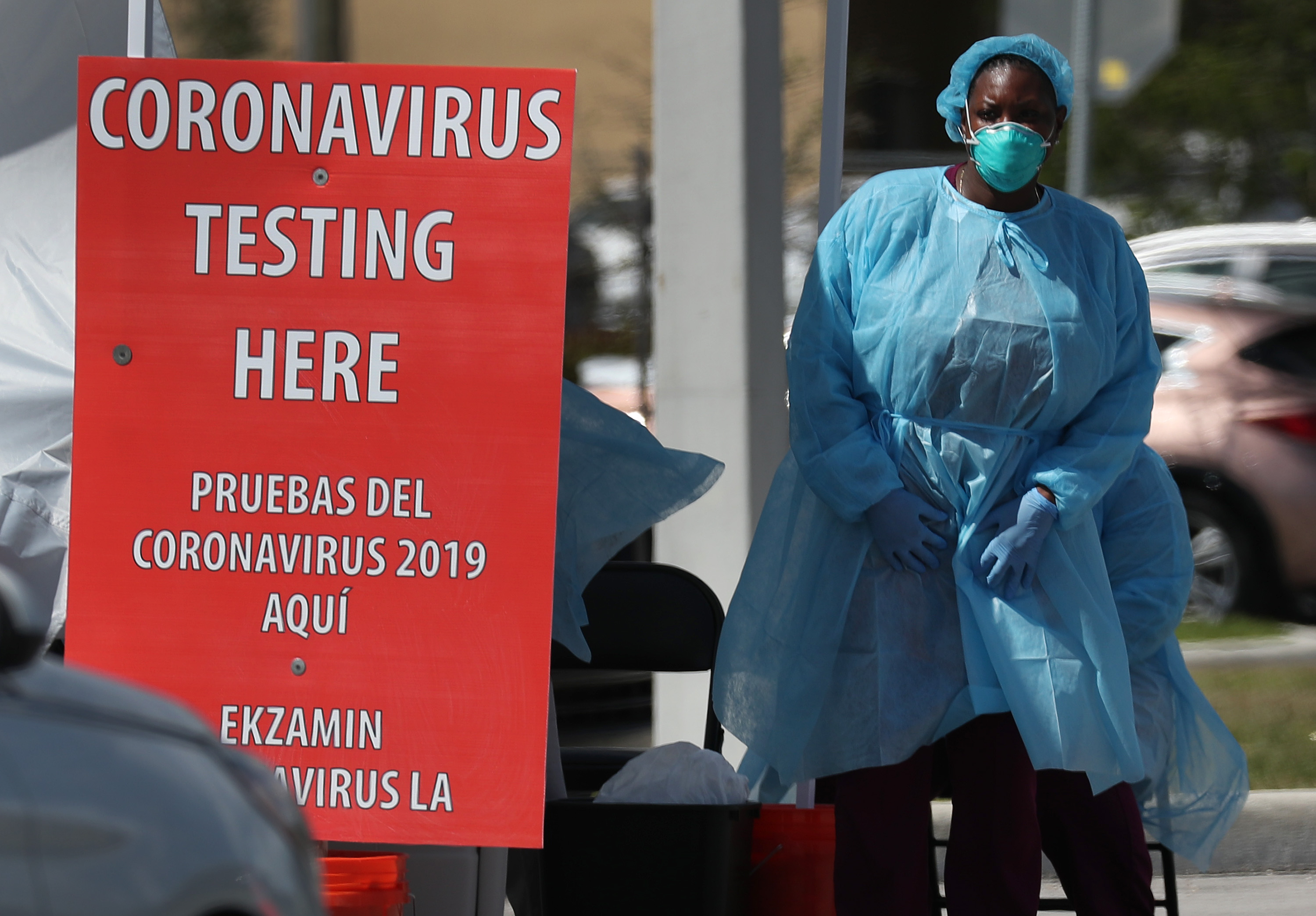 A member of the health care staff from the Community Health of South Florida, Inc. (CHI) prepares to test people for the coronavirus in the parking lot of its Doris Ison Health Center on March 18 in Miami, Florida.