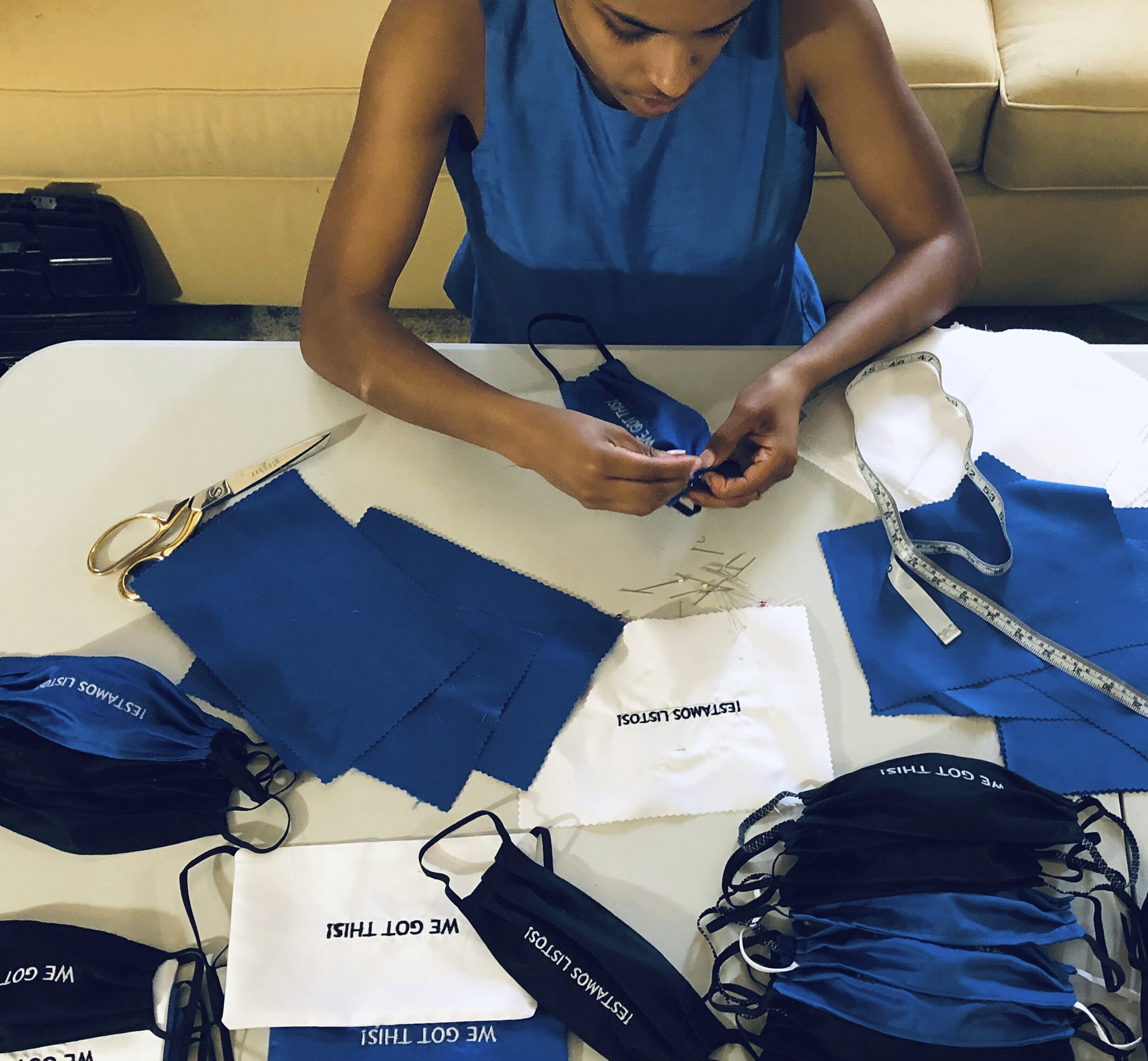 Briana Danyele sews cloth face masks that say  We Got This!  in her mother's living room which will be sent to health care workers in Greer, S.C., on March 22, 2020