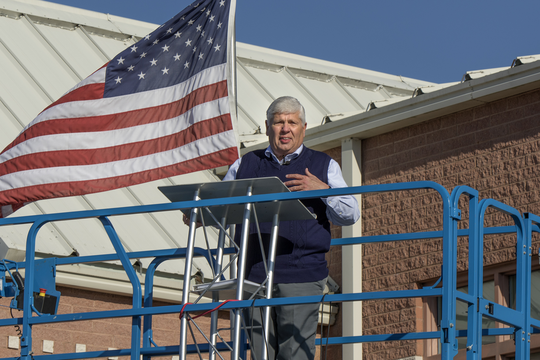Pastor Frank Carl preaches atop a scissor lift at Genoa Church in Westerville, Ohio