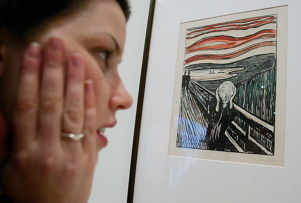 Madeline Wilson from the National Gallery of Victoria inspects Edvard Munch's famous hand-coloured lithograph version of  The Scream.