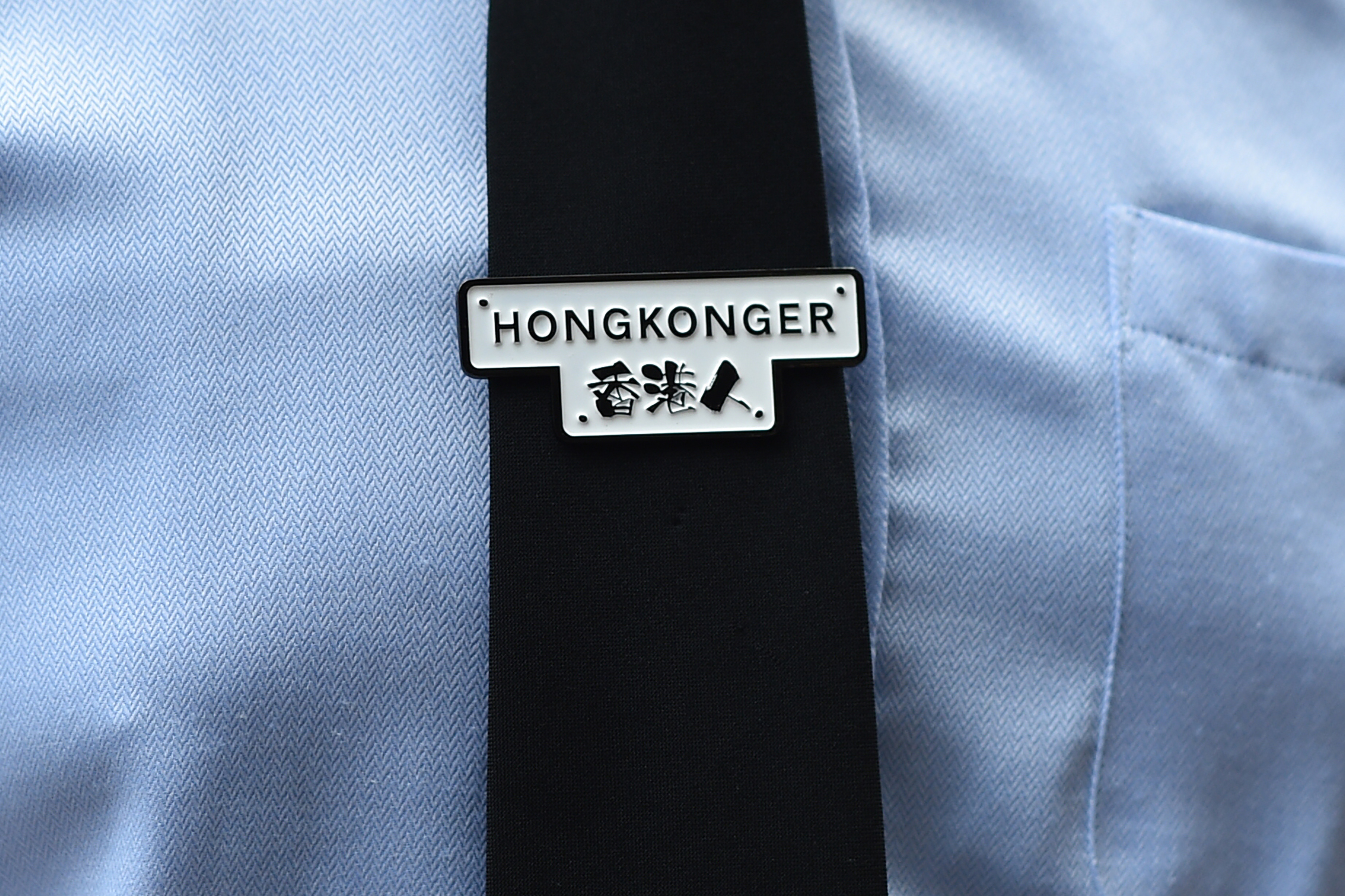 A tie clip that reads  Hongkonger  is worn by a protester outside the High Court during a gathering in support of activist Edward Leung, in Hong Kong on October 9, 2019.