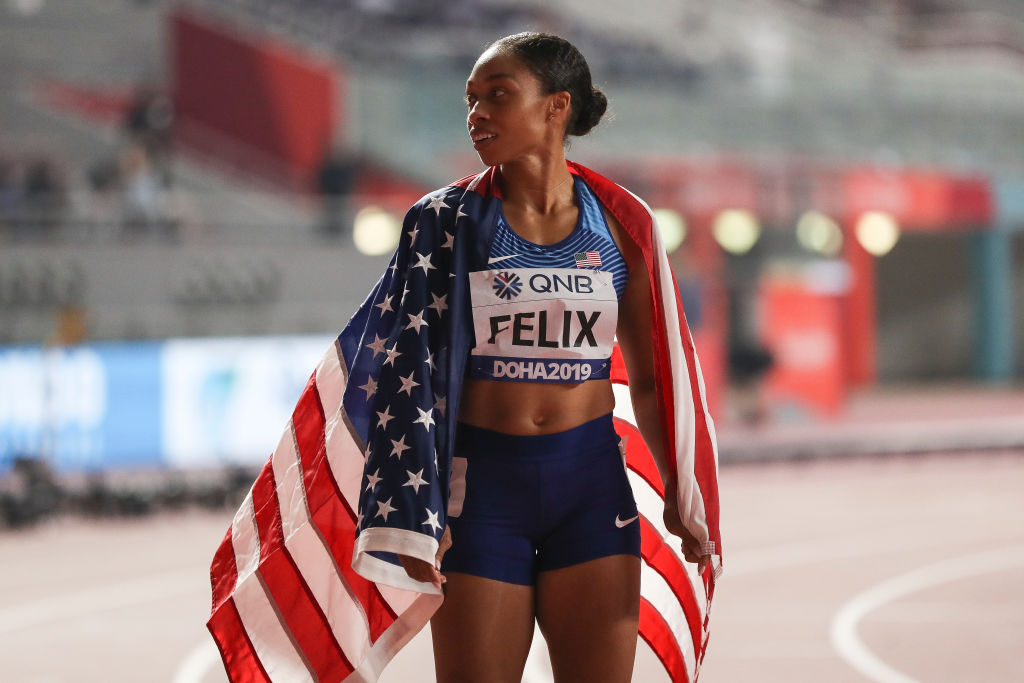 Allyson Felix of the United States poses after setting a new world record in the 4x400 Metres Mixed Relay during day three of 17th IAAF World Athletics Championships Doha 2019 at Khalifa International Stadium on September 29, 2019 in Doha, Qatar.