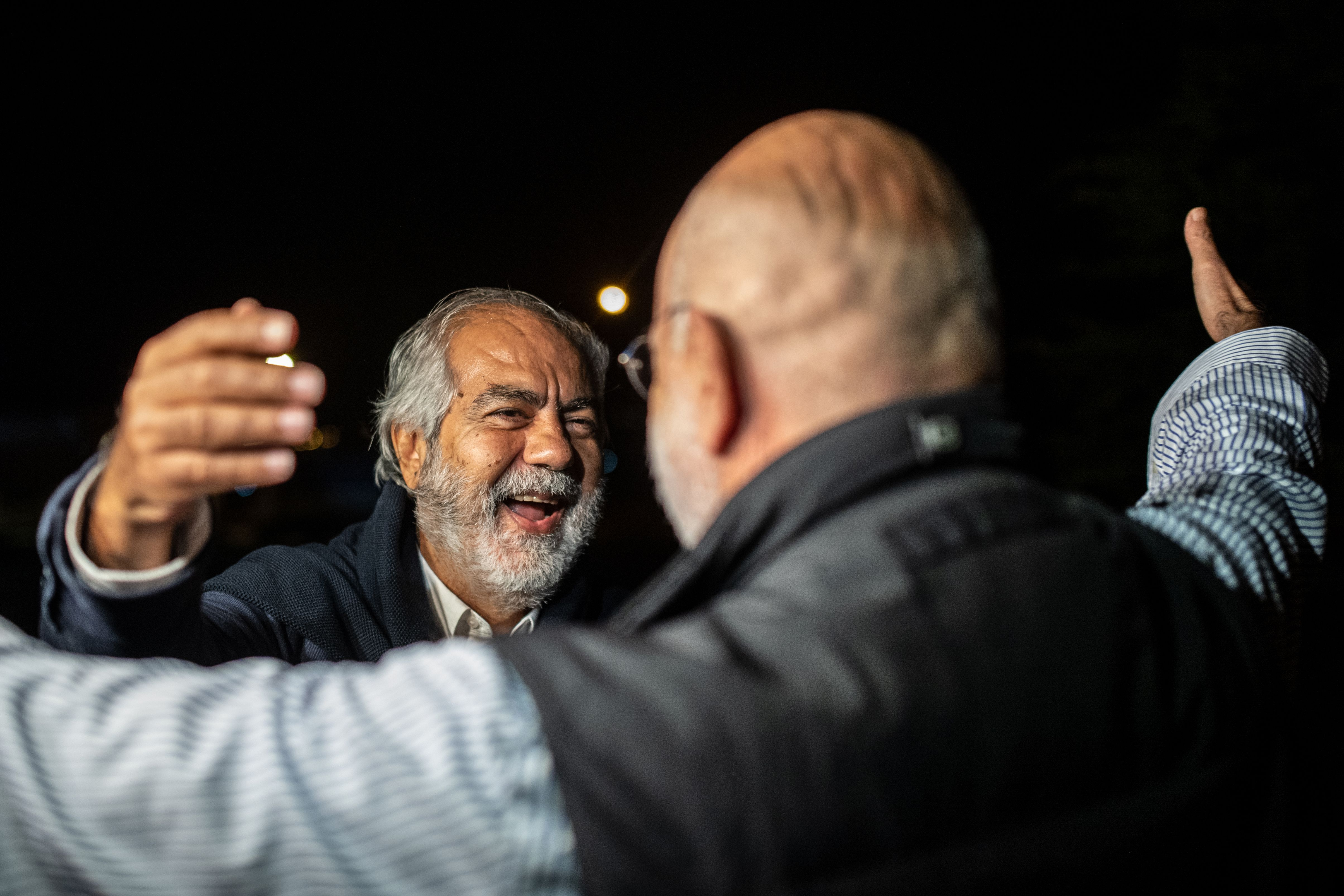 Turkish journalist and writer Ahmet Altan embraces his brother Mehmet (L) after being released on Nov. 4, 2019. Ahmet Altan was re-arrested a week later.