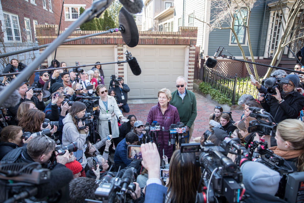 Democratic presidential candidate Sen. Elizabeth Warren (D-MA), with husband Bruce Mann, announces that she is dropping out of the presidential race during a media availability outside of her home in Cambridge, MA, on March 5, 2020.