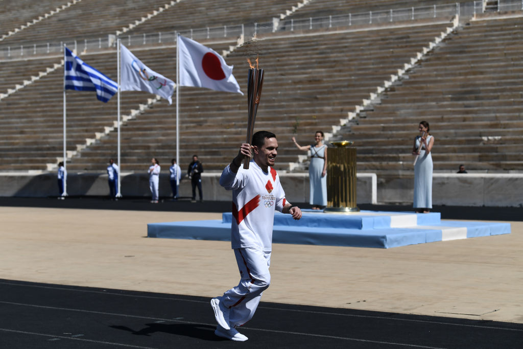 An athlete carries the olympic torch during one of the last relays ahead of the olympic flame handover ceremony for the 2020 Tokyo Summer Olympics in Athens, Greece on March 19, 2020.