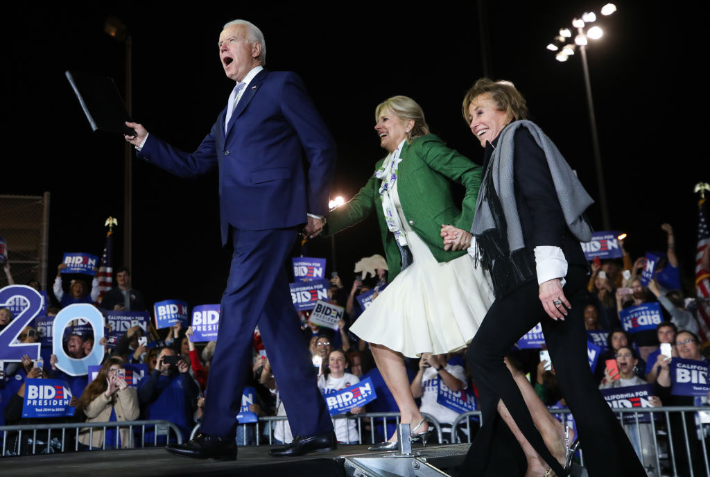 Democratic presidential candidate former Vice President Joe Biden arrives with wife Jill (C) and sister Valerie at a Super Tuesday campaign event at Baldwin Hills Recreation Center in Los Angeles, California, on March 3, 2020.