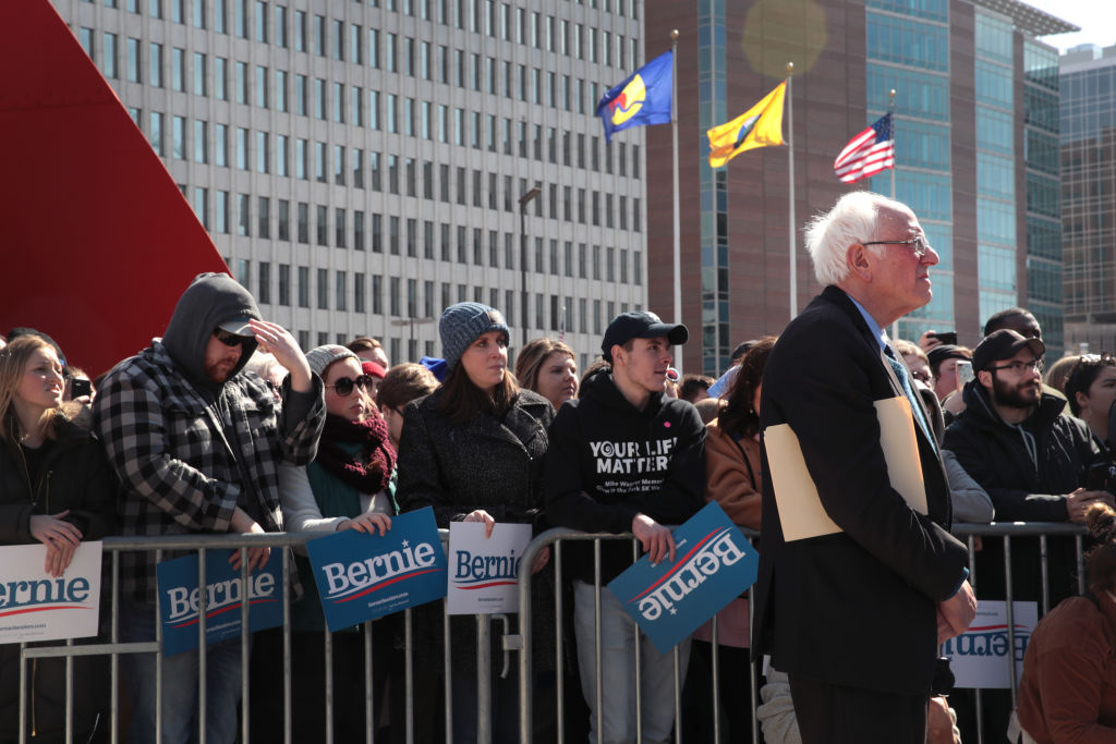 Democratic presidential candidate Sen. Bernie Sanders (I-VT) listens as Rev. Jesse Jackson addresses the crowd during Sander's campaign rally in Calder Plaza in Grand Rapids, Michigan, on March 08, 2020