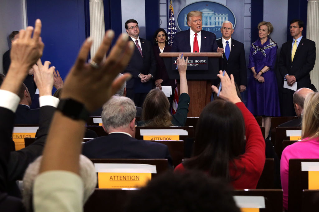 Flanked by members of the Coronavirus Task Force, U.S. President Donald Trump speaks during a news briefing on the latest development of the coronavirus outbreak in the U.S. at the James Brady Press Briefing Room at the White House in Washington, DC, on March 18, 2020.
