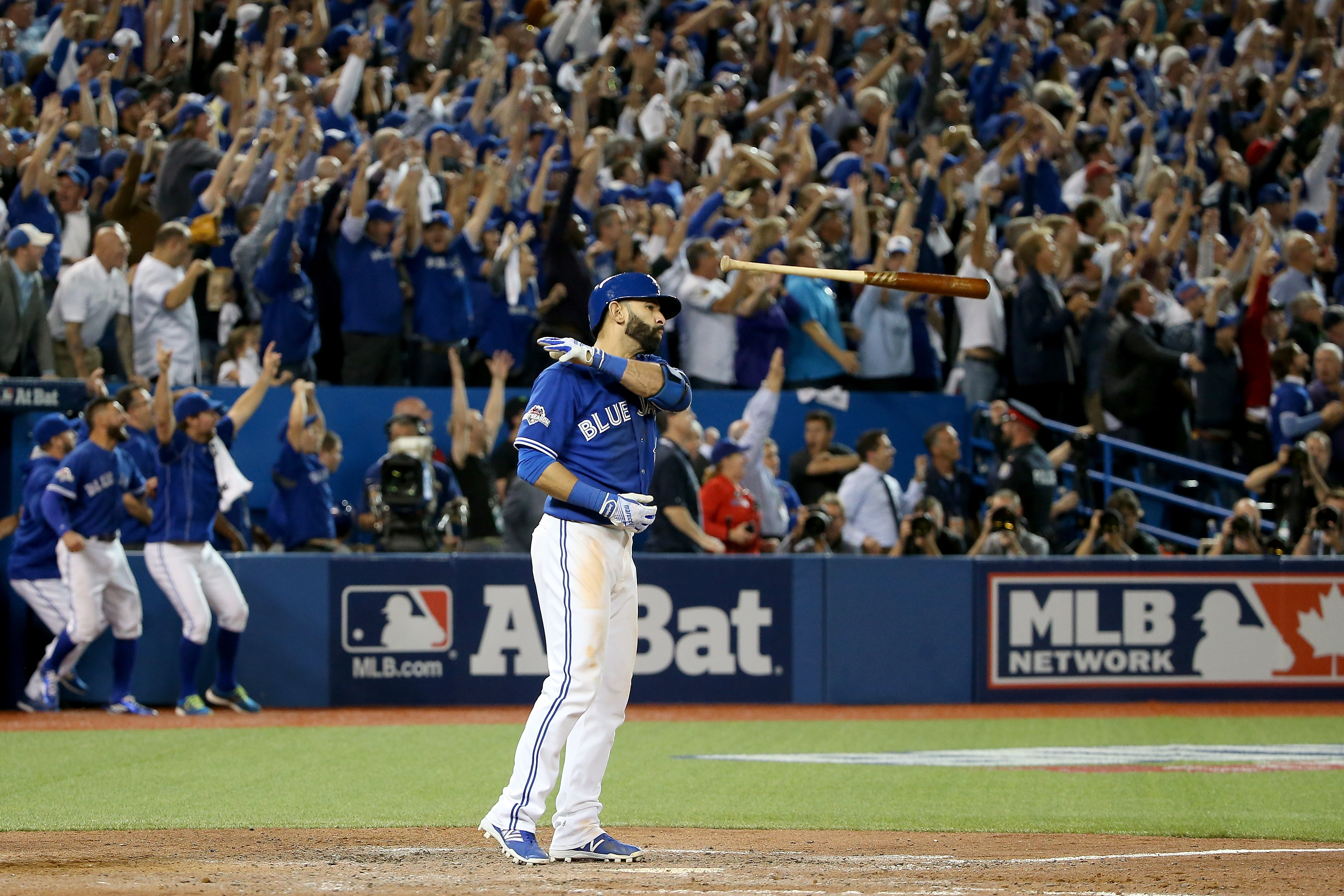 Jose Bautista of the Toronto Blue Jays flips his bat up in the air after he hits a three-run home run in the seventh inning against the Texas Rangers in game five of the American League Division Series at Rogers Centre on October 14, 2015 in Toronto, Canada.
