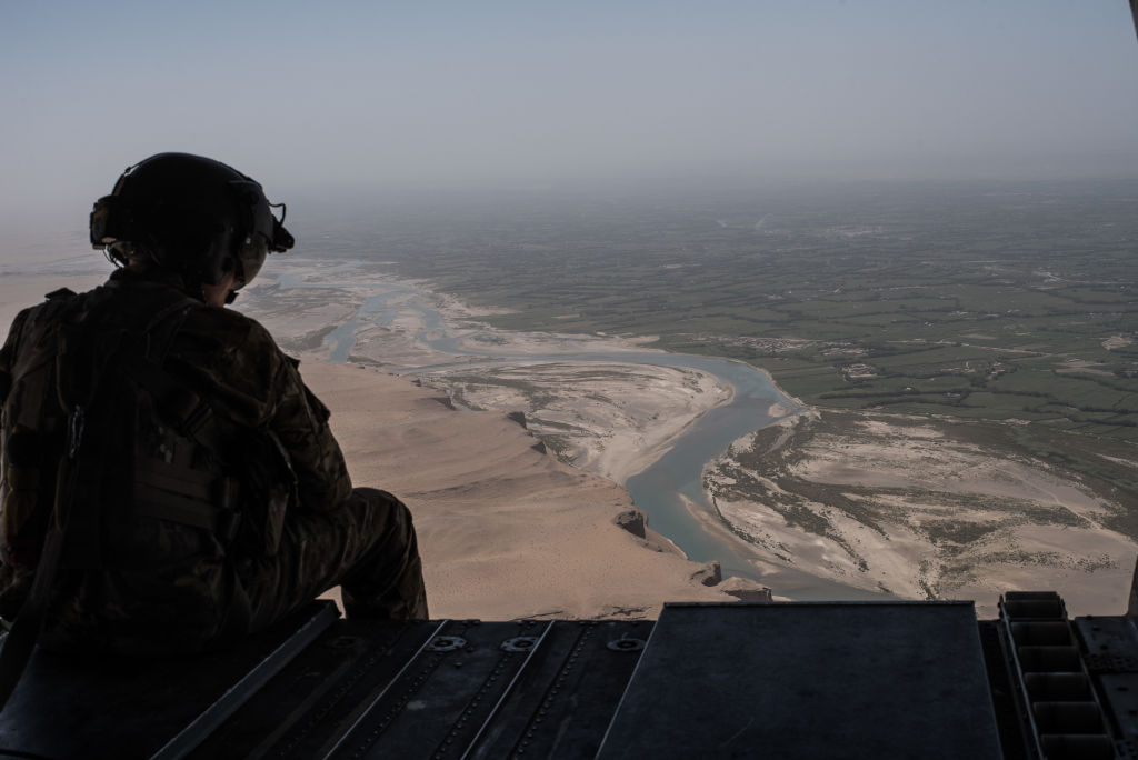 A U.S. Army helicopter flies outside of Camp Shorab in Helmand Province, Afghanistan, on September 11, 2017.