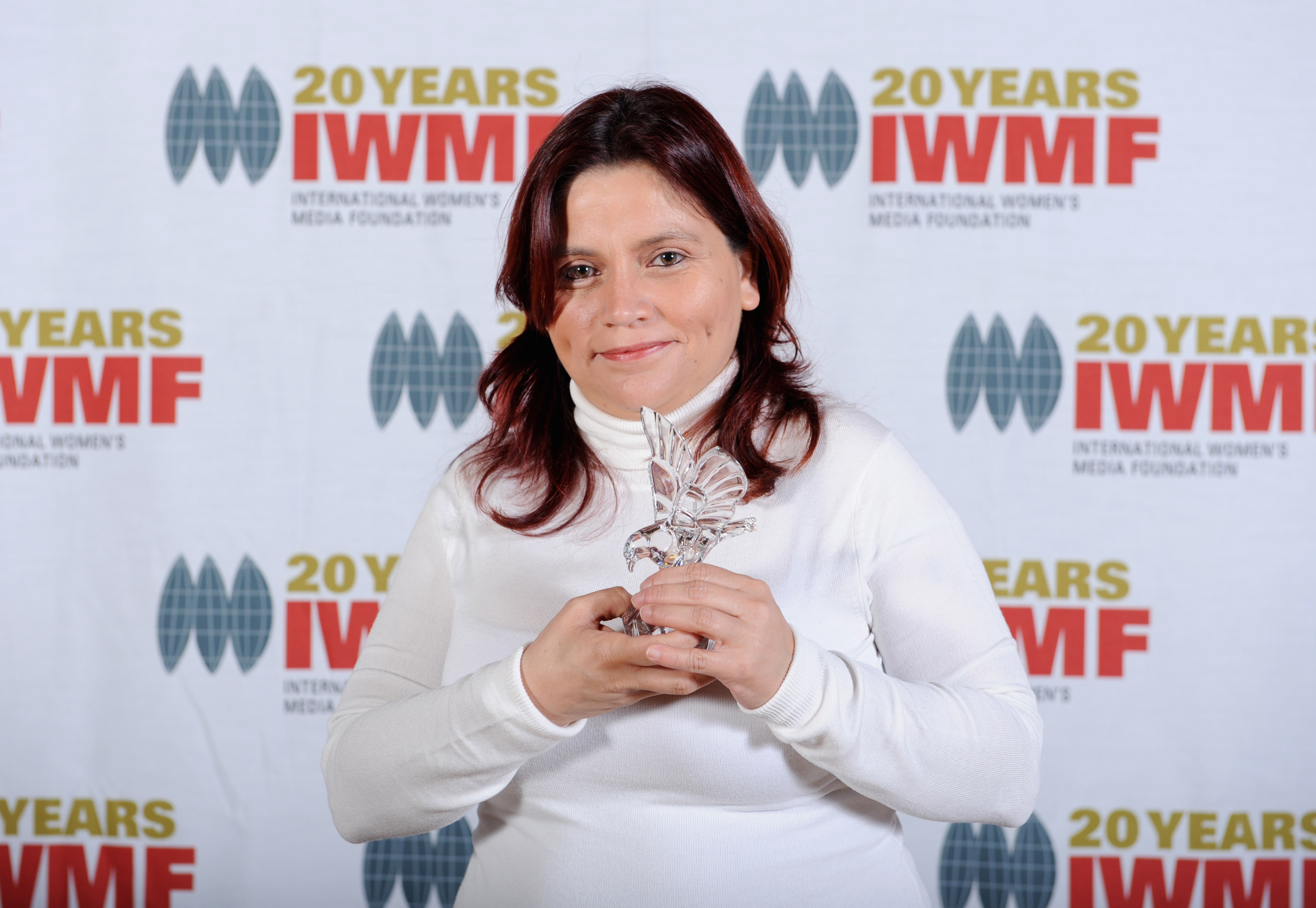 Claudia Julieta Duque of Colombia holds her 2010 Courage in Journalism Award at the International Women's Media Foundation lunch on Oct. 19, 2010 at the Waldorf Astoria Hotel in New York.