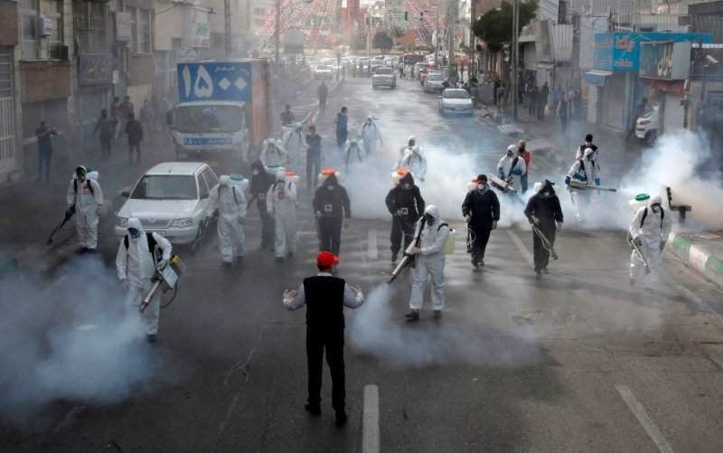 Iranian Firefighters disinfect streets in the capital Tehran in a bid to halt the spread of the coronavirus on March 13 2020.