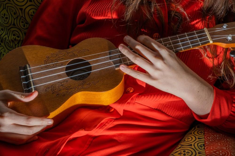 5:27 P.M. Playing the ukulele