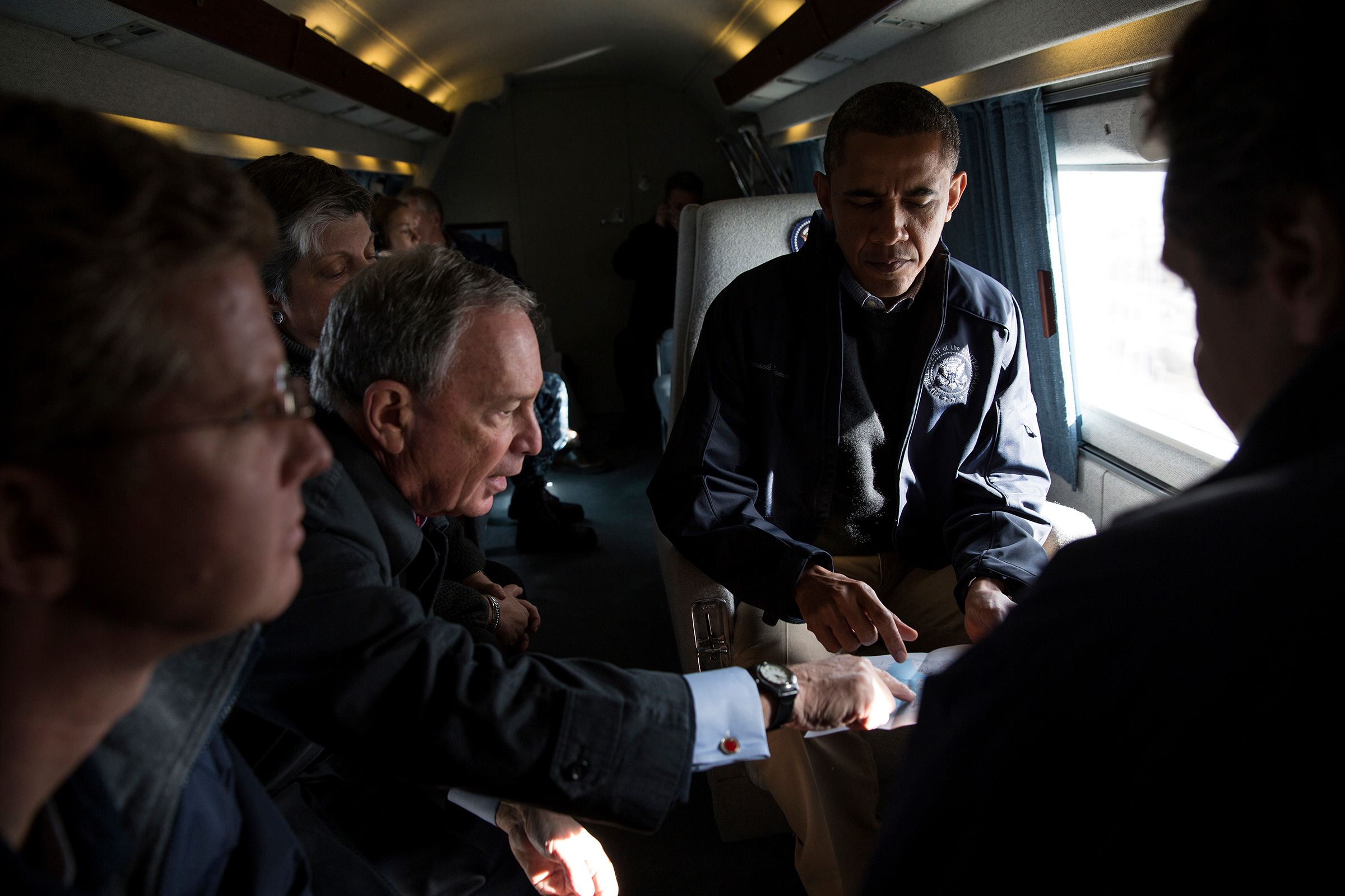 Bloomberg, the New York City mayor, views a map with President Obama during an aerial tour to view damage there from Superstorm Sandy on Nov. 15, 2012.