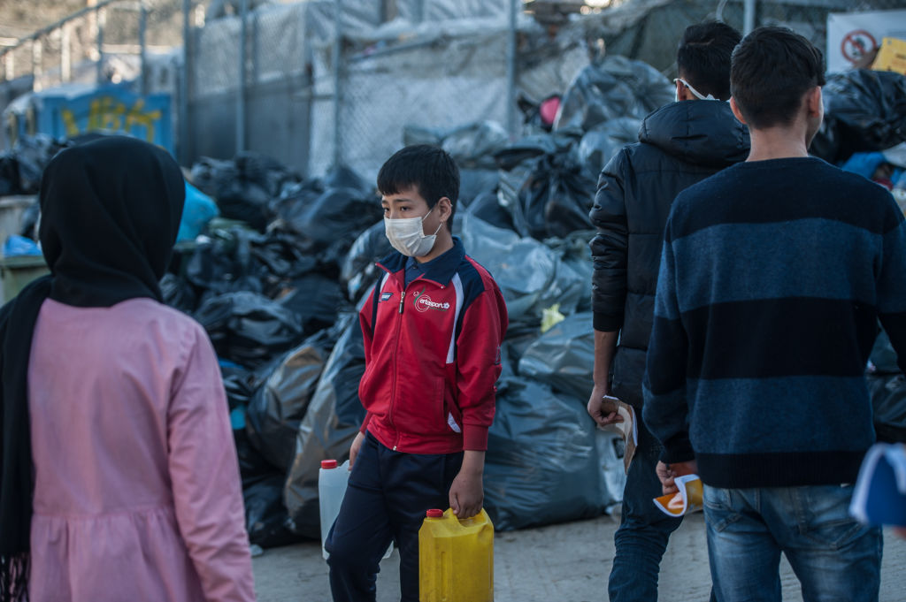 Camp residents wear surgical masks to protect from coronavirus on March 12, 2020 in Mytilene, Greece.