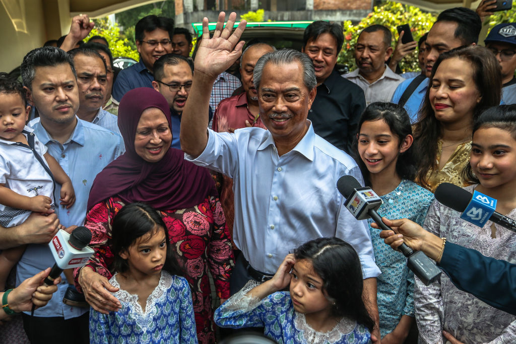 Former home affairs minister Muhyiddin Yassin celebrates after being appointed Malaysia's 8th Prime Minister in Kuala Lumpur on Feb. 29, 2020.