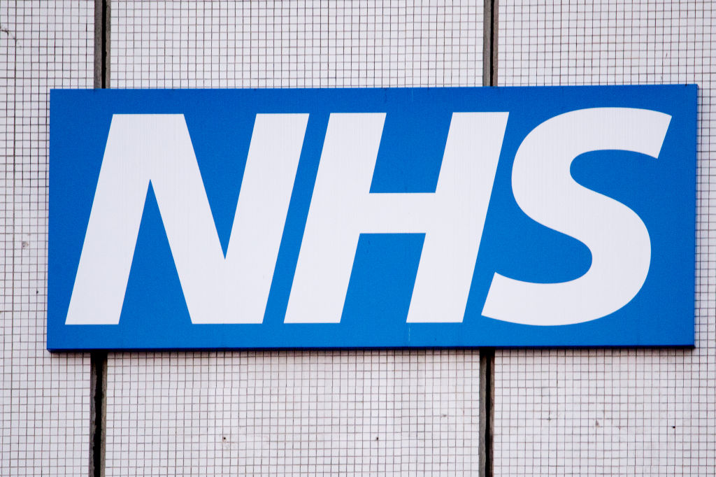 An NHS sign at St Thomas's Hospital, on March 24, 2020 in London. British Prime Minister, Boris Johnson, announced strict lockdown measures urging people to stay at home and only leave the house for basic food shopping, exercise once a day and essential travel to and from work.