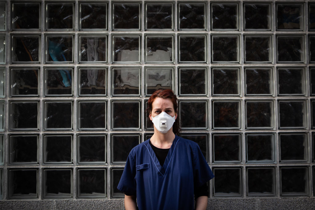 A nurse wears a face mask as a precaution against transmission of the coronavirus on March 12 in Madrid, Spain.