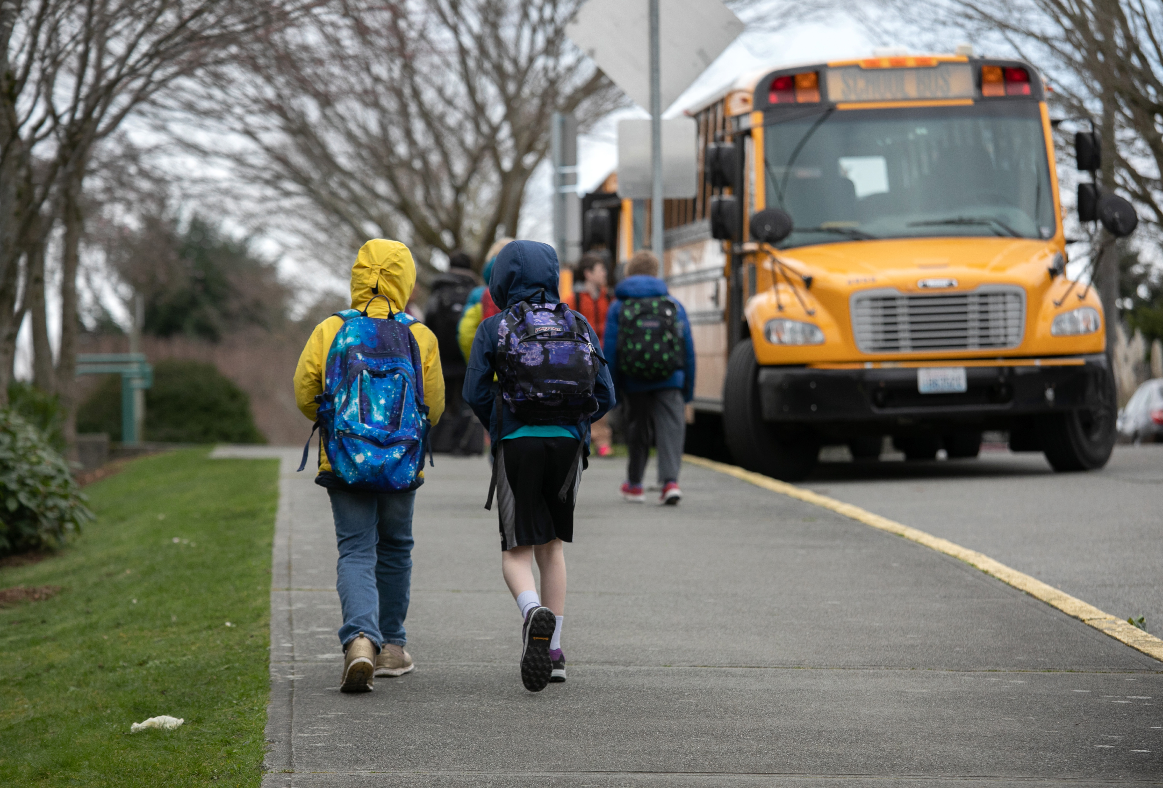 Students leave an elementary school in Seattle, Washington, after the Seattle Public School system closed due to coronavirus concerns on March 11, 2020.