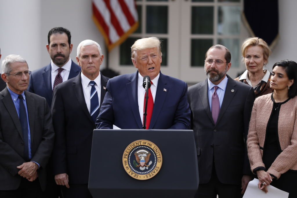 U.S. President Donald Trump, center, speaks during a news conference in the Rose Garden of the White House in Washington, D.C., U.S., on Friday, March 13, 2020.