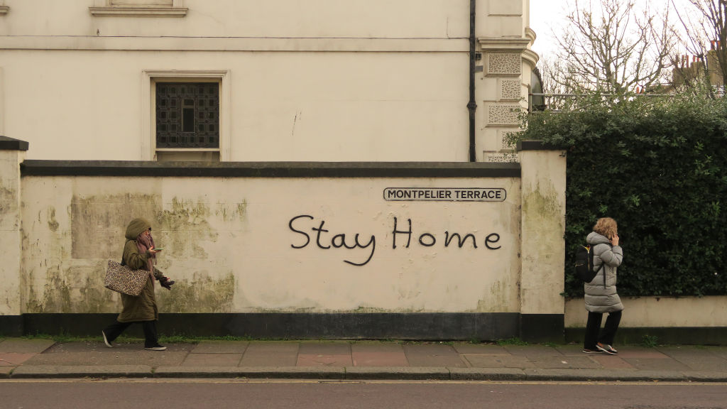 Stay home  is graffitied on a wall in Brighton on March 17, 2020 in Brighton, England. Boris Johnson held the first of his public daily briefing on the Coronavirus outbreak yesterday and told the public to avoid theatres, going to the pub and work from home where possible. The number of people infected with COVID-19 in the UK reached 1500 today with 36 deaths.