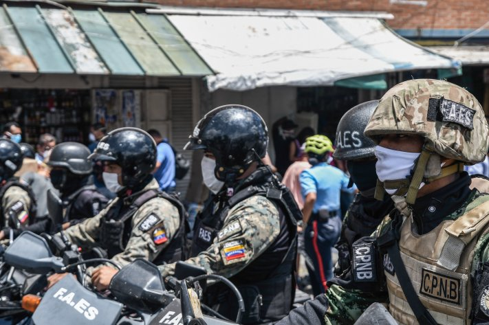Police officers in Caracas, Venezuela enforce Nicolás Maduro's nationwide quarantine order to contain the coronavirus, on March 18, 2020.