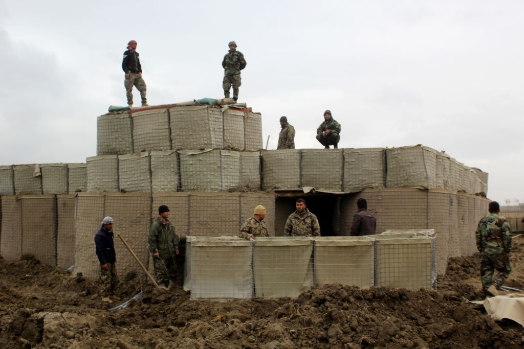 Afghan security forces stand guard at an outpost after an attack by Taliban militants in Kunduz Province, Afghanistan, on Mar. 4, 2020.