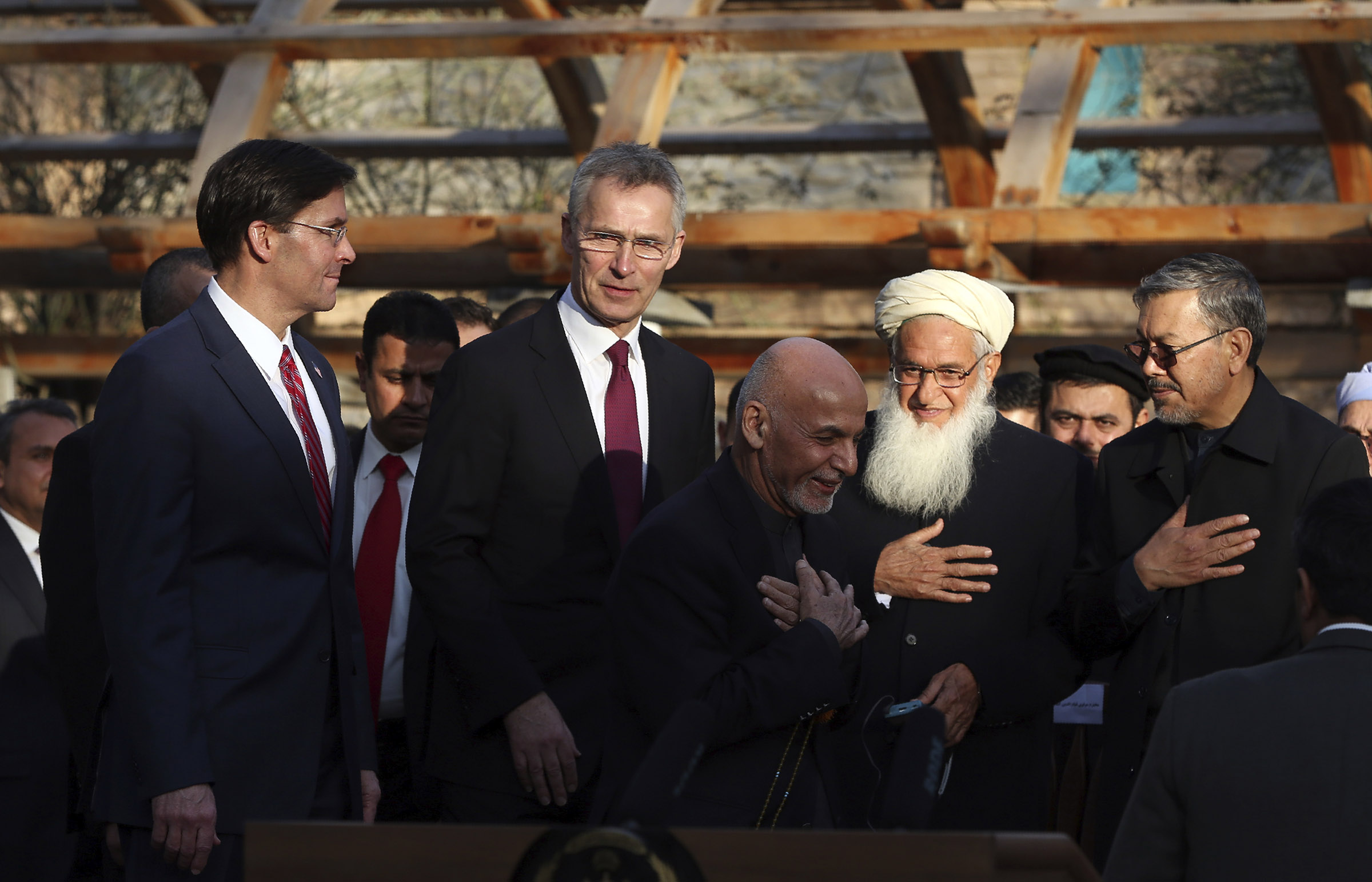 Afghan President Ashraf Ghani, center, arrives with NATO Secretary General Jens Stoltenberg, and U.S. Secretary of Defense Mark Esper for a joint news conference at the presidential palace in Kabul, Afghanistan on Feb. 29, 2020.