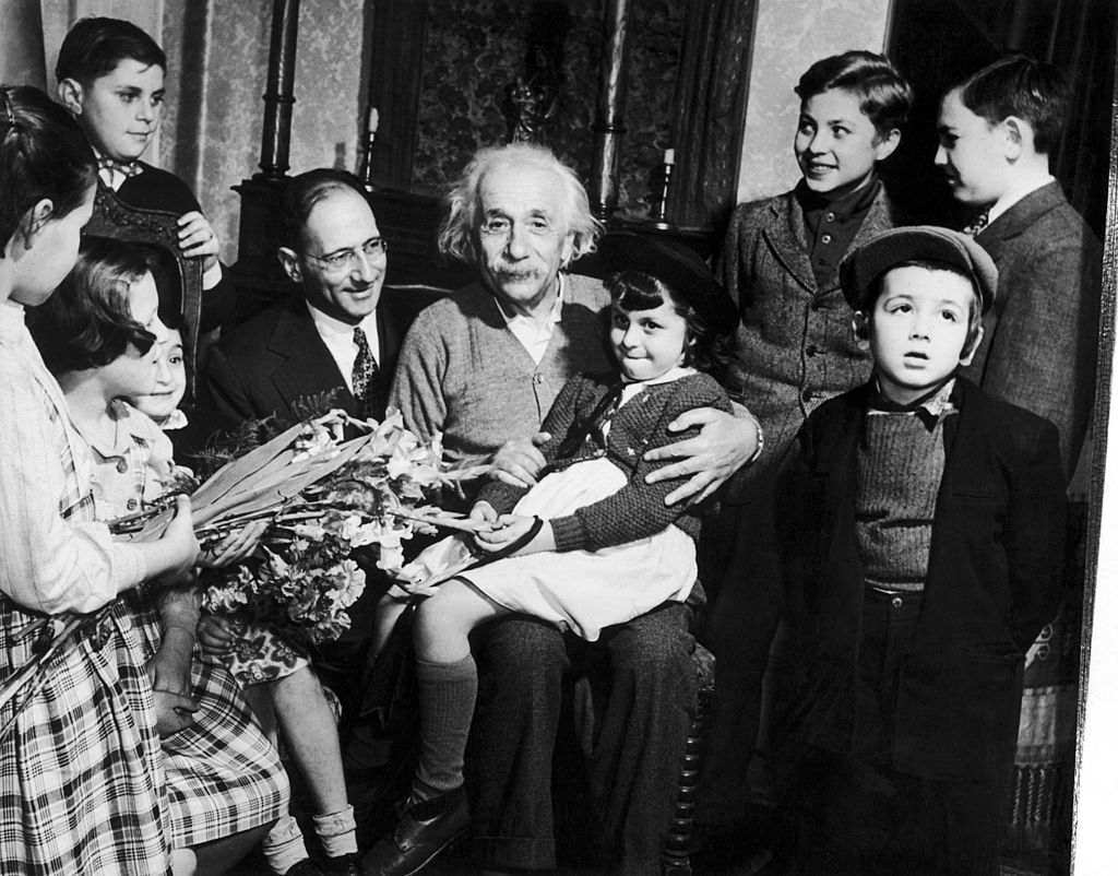 Albert Einstein celebrating his 70th birthday with children from a displaced persons camp on Mar. 13, 1949, at his home in Princeton, N.J.