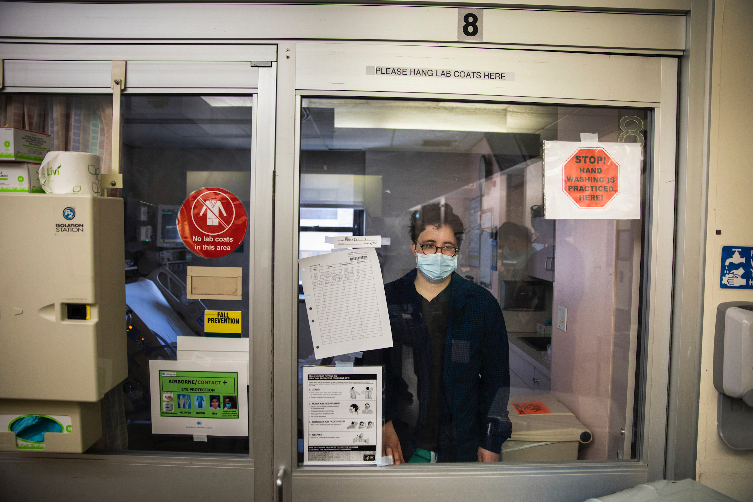 It's not easy being a patient, especially in your own hospital.  Dr. Laura Mulvey, who practices emergency medicine, in her isolation unit in the ICU at Maimonides Medical Center in Brooklyn on March 26, 2020.