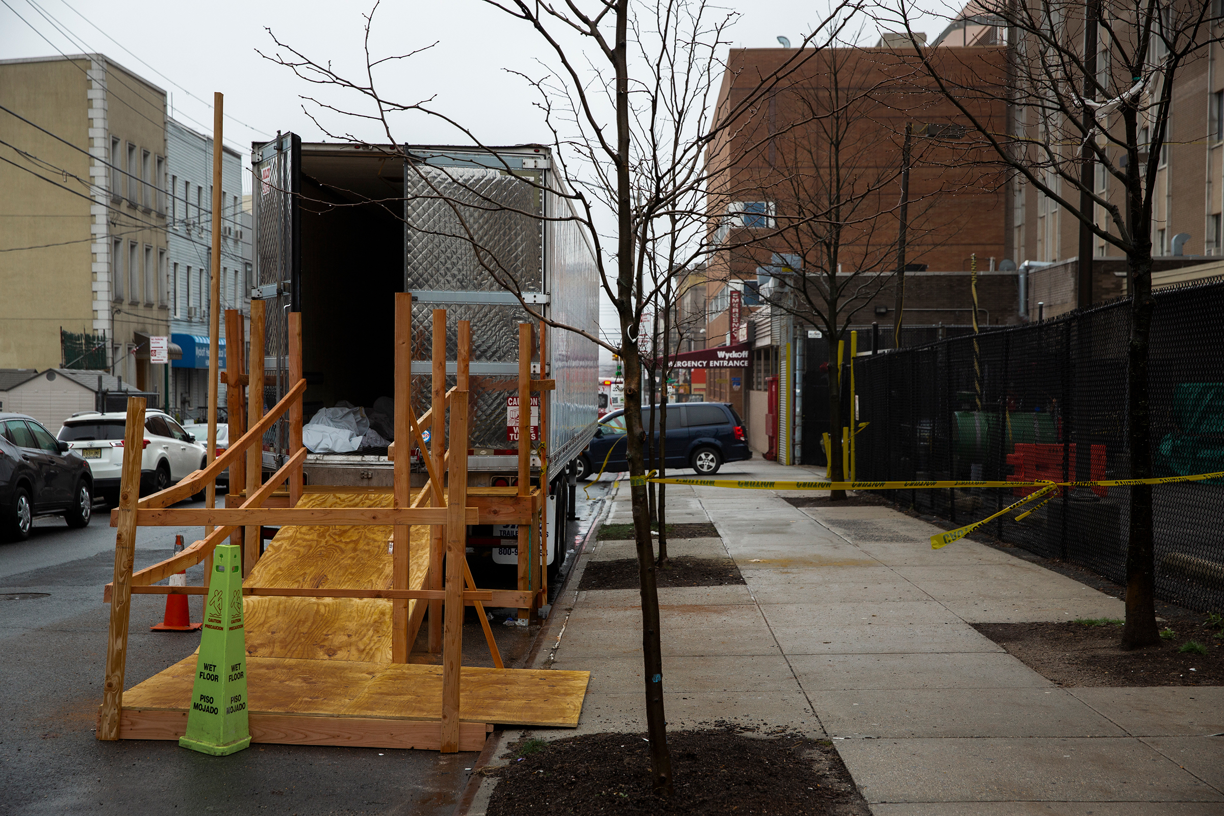 A covered body is seen in the back of a temporary morgue erected outside Wyckoff Heights Medical Center in Brooklyn, New York, on March 29, 2020.