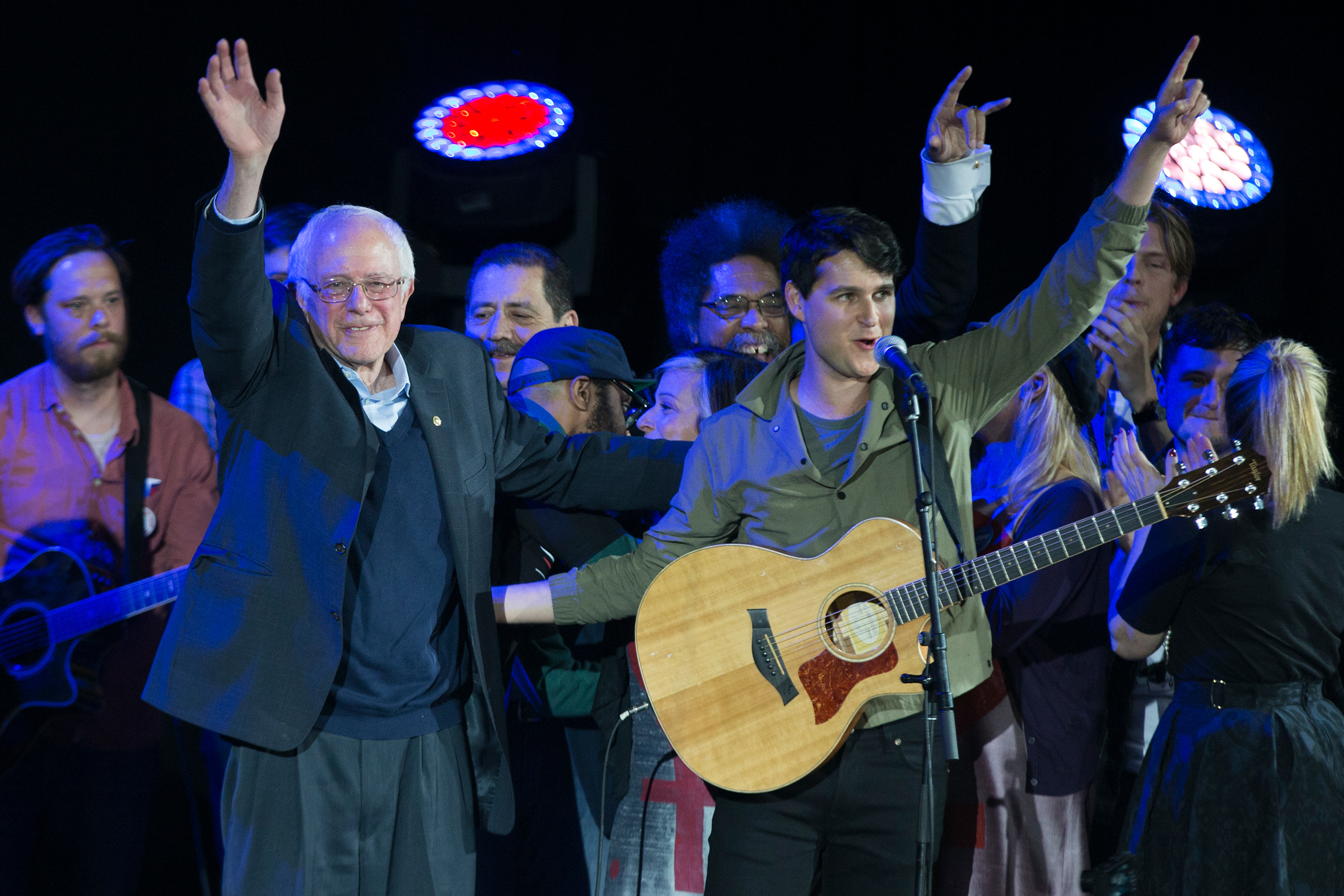 Democratic presidential candidate Sen. Bernie Sanders, and Vampire Weekend lead singer Ezra Koenig wave during a campaign rally at the University of Iowa on Jan. 30, 2016