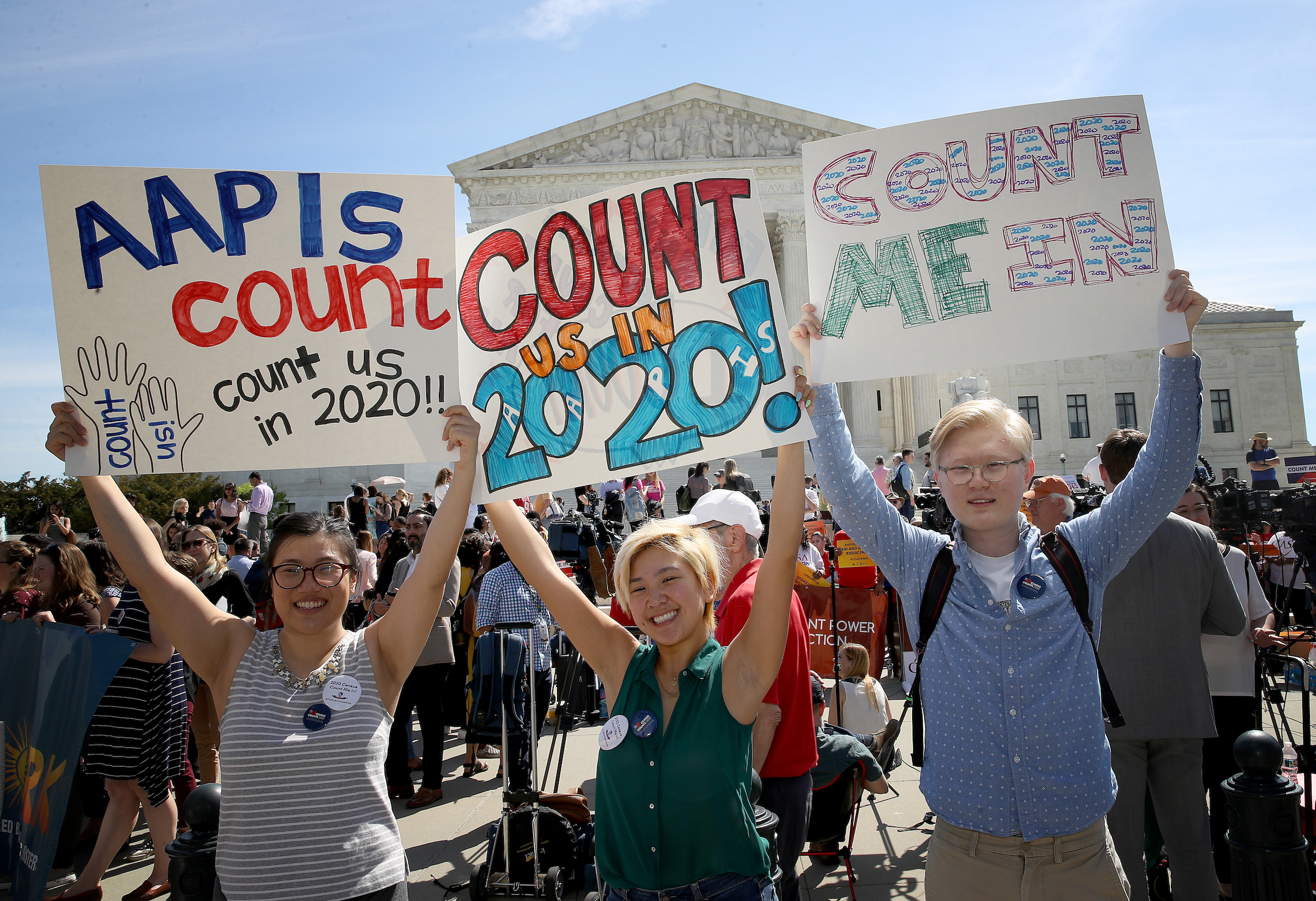 Protesters gather outside the U.S. Supreme Court as the court hears oral arguments in a Census-related case on April 23, 2019 in Washington, D.C.