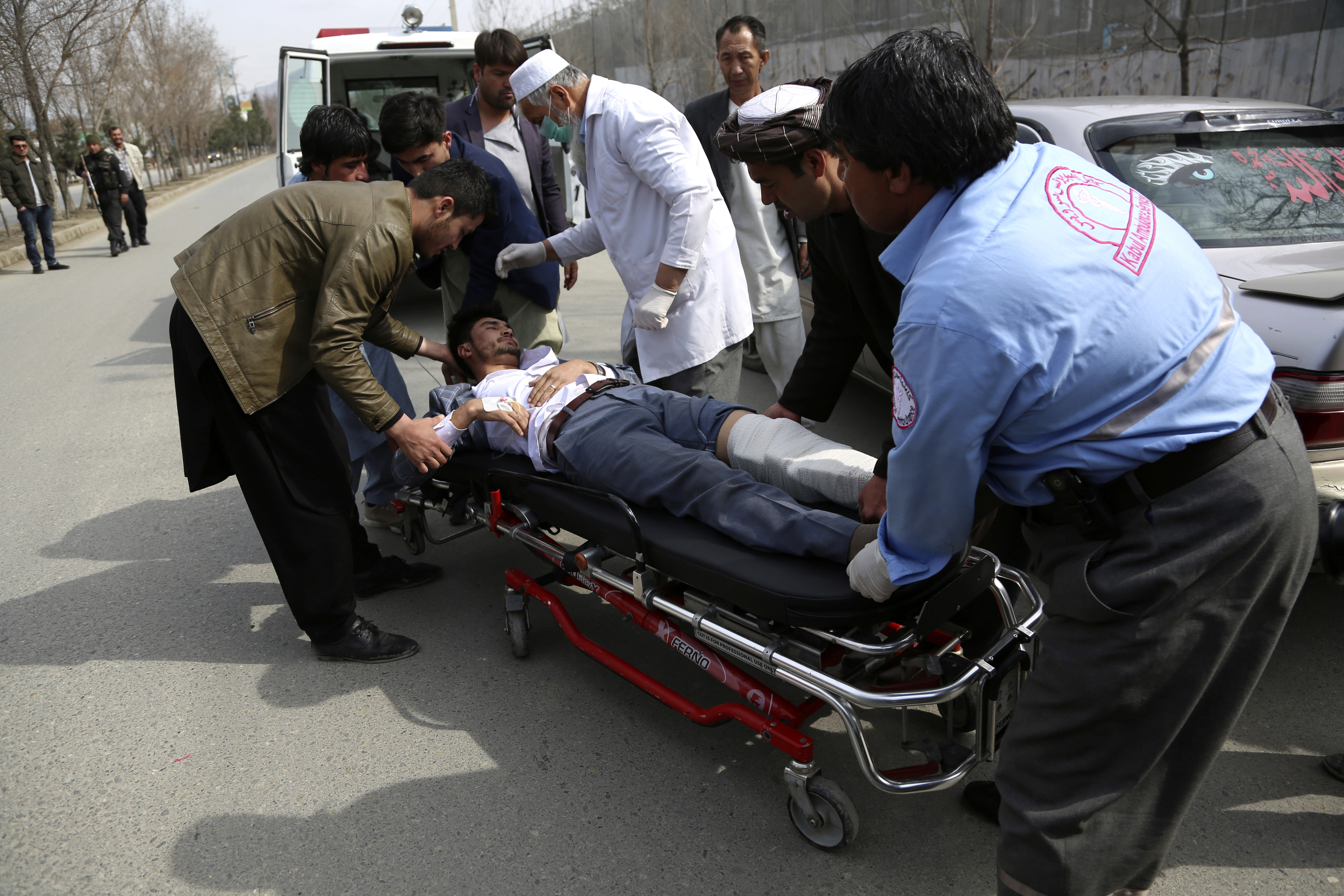 An injured man is carried into an ambulance after an attack in Kabul, Afghanistan, on March 6, 2020.