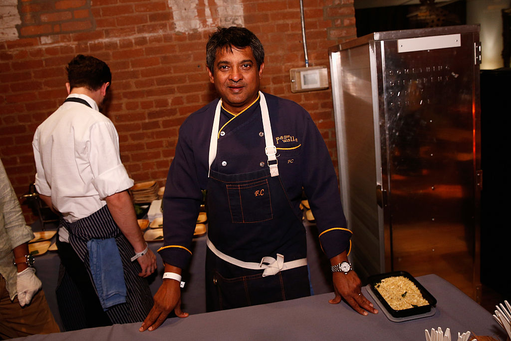 Chef Floyd Cardoz with kerala style banana leaf salmon from Paowalla at the 2016 New York Taste presented by Citi hosted by New York Magazine on November 1, 2016 in New York City.