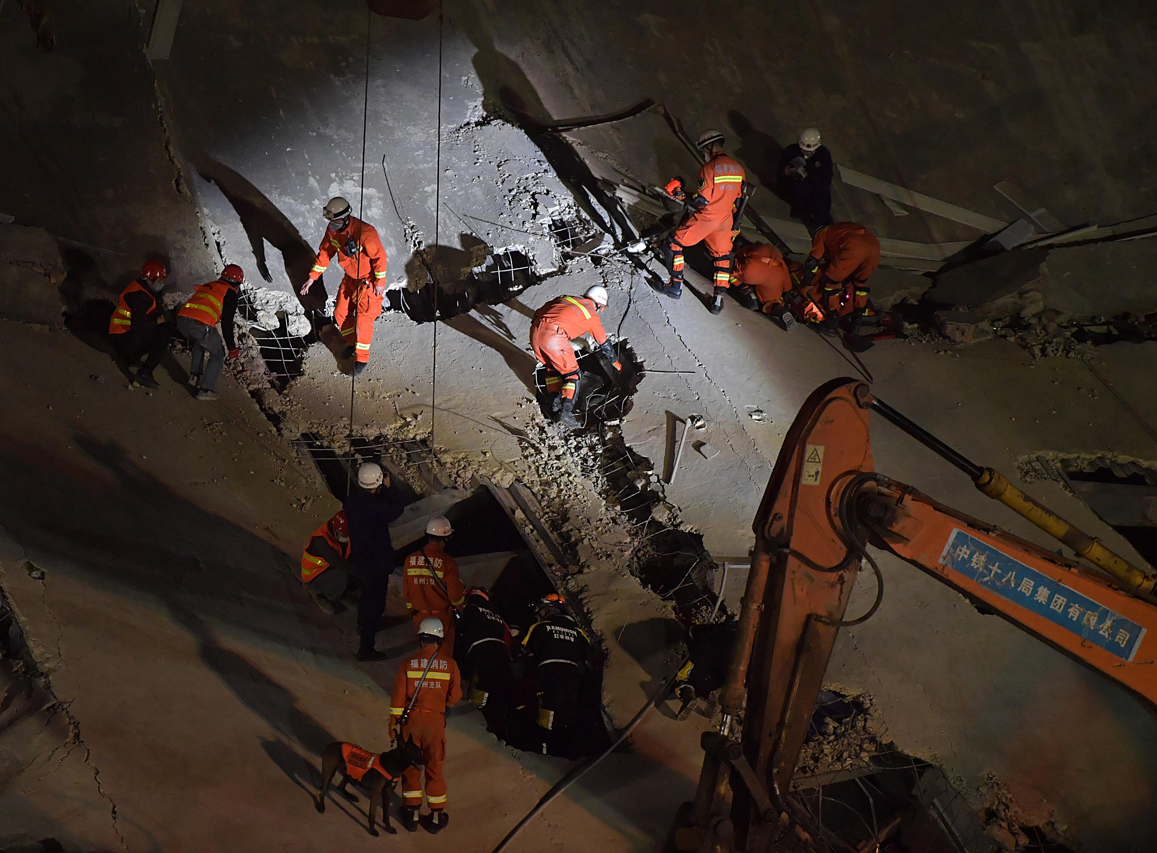 Rescuers search for survivors in the rubble of a collapsed hotel on March 8, 2020 in Quanzhou, China.