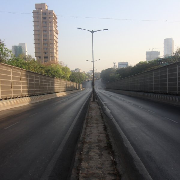 An empty road is seen during a nationwide curfew in response to the outbreak of the coronavirus (COVID-19) pandemic in Mumbai, India on March 22, 2020.