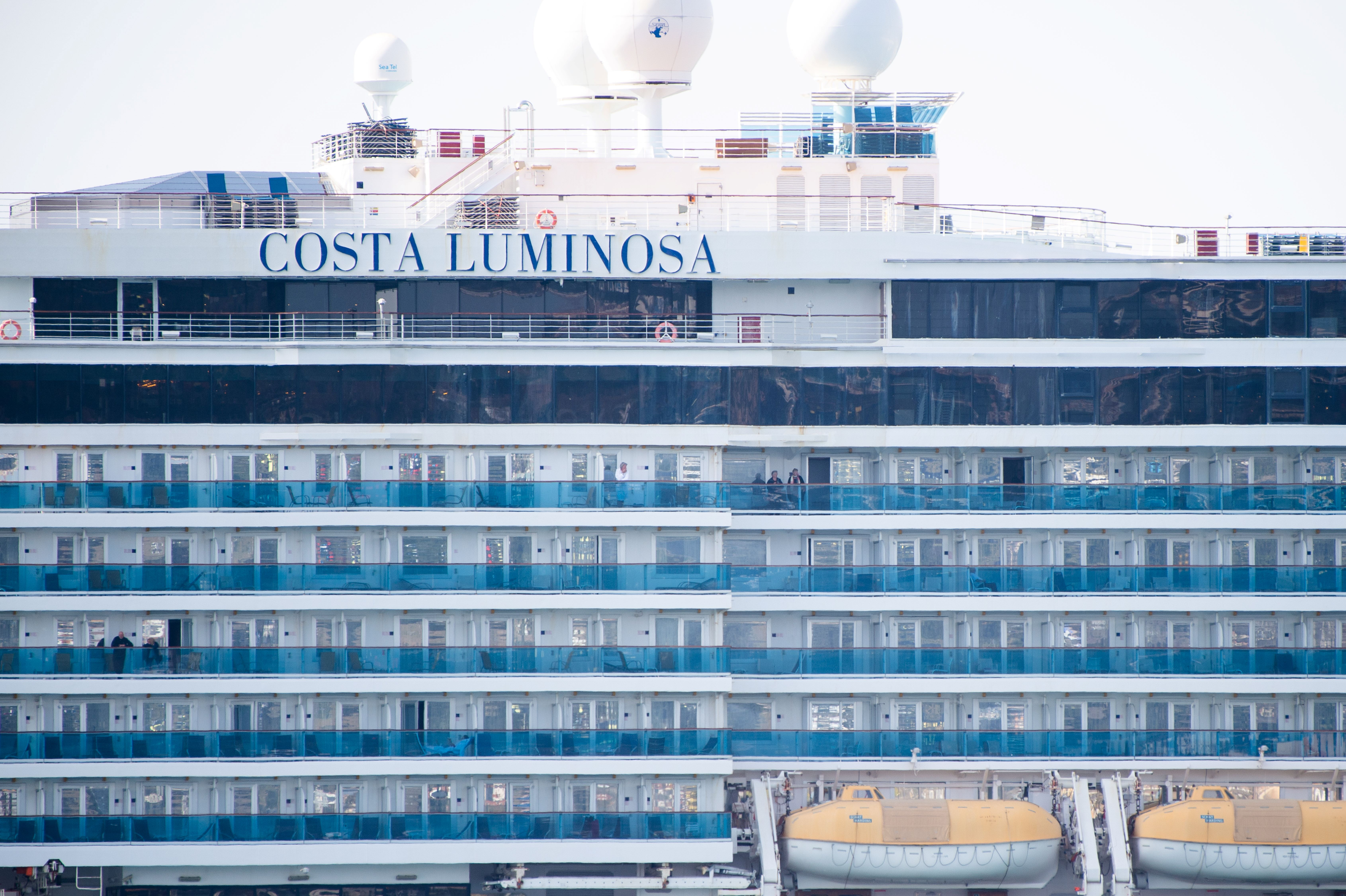 Passengers on the cruise ship Costa Luminosa are seen as the ship is moored at Marseille harbor on March 20, 2020. The Costa Luminosa is under quarantine due to several cases of COVID-19 among the passengers.