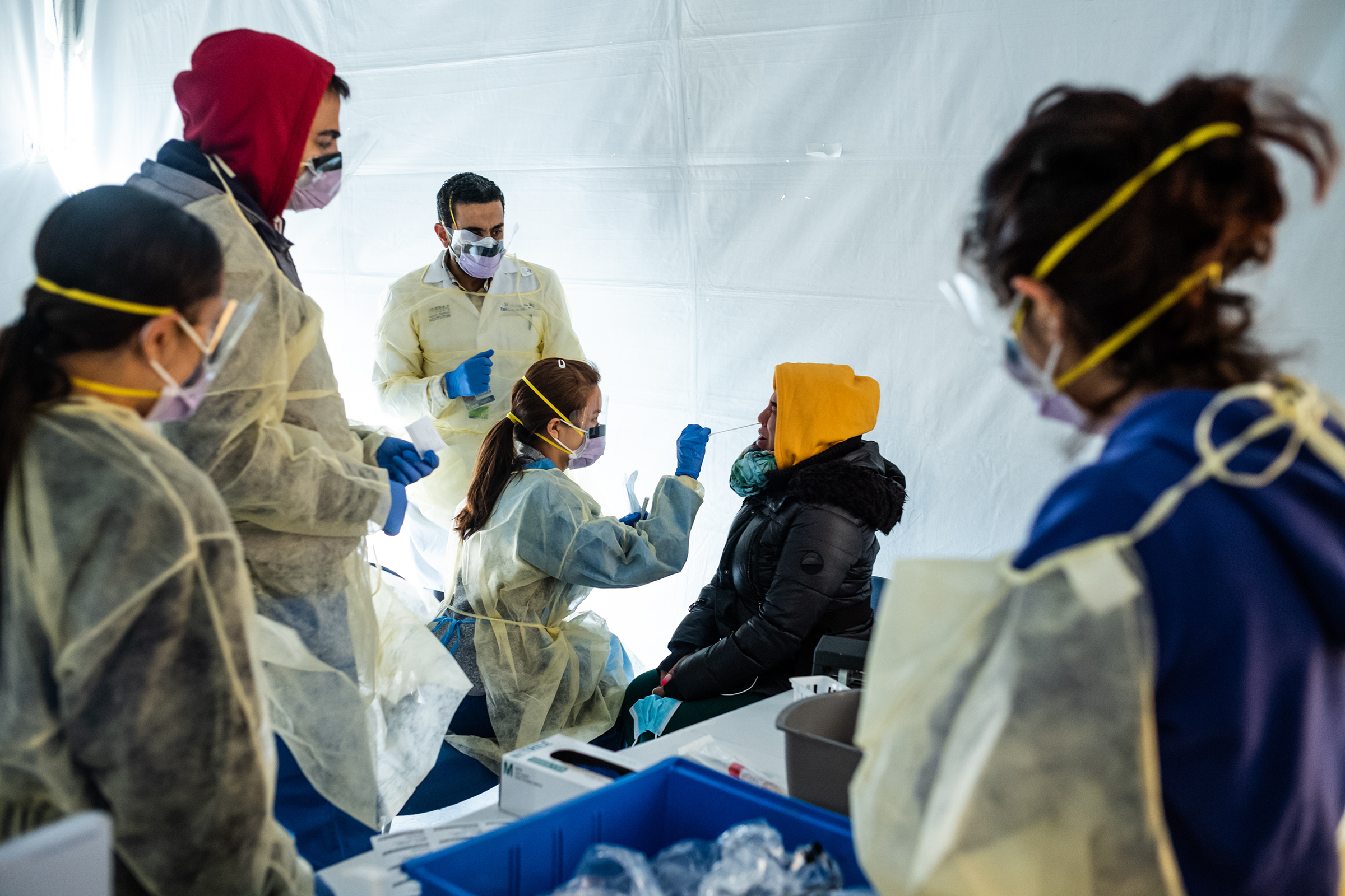 Doctors test hospital staff in set-up tents to triage possible COVID-19 patients outside before they enter the main Emergency department at St. Barnabas hospital in the Bronx on March 24, 2020 in New York City.