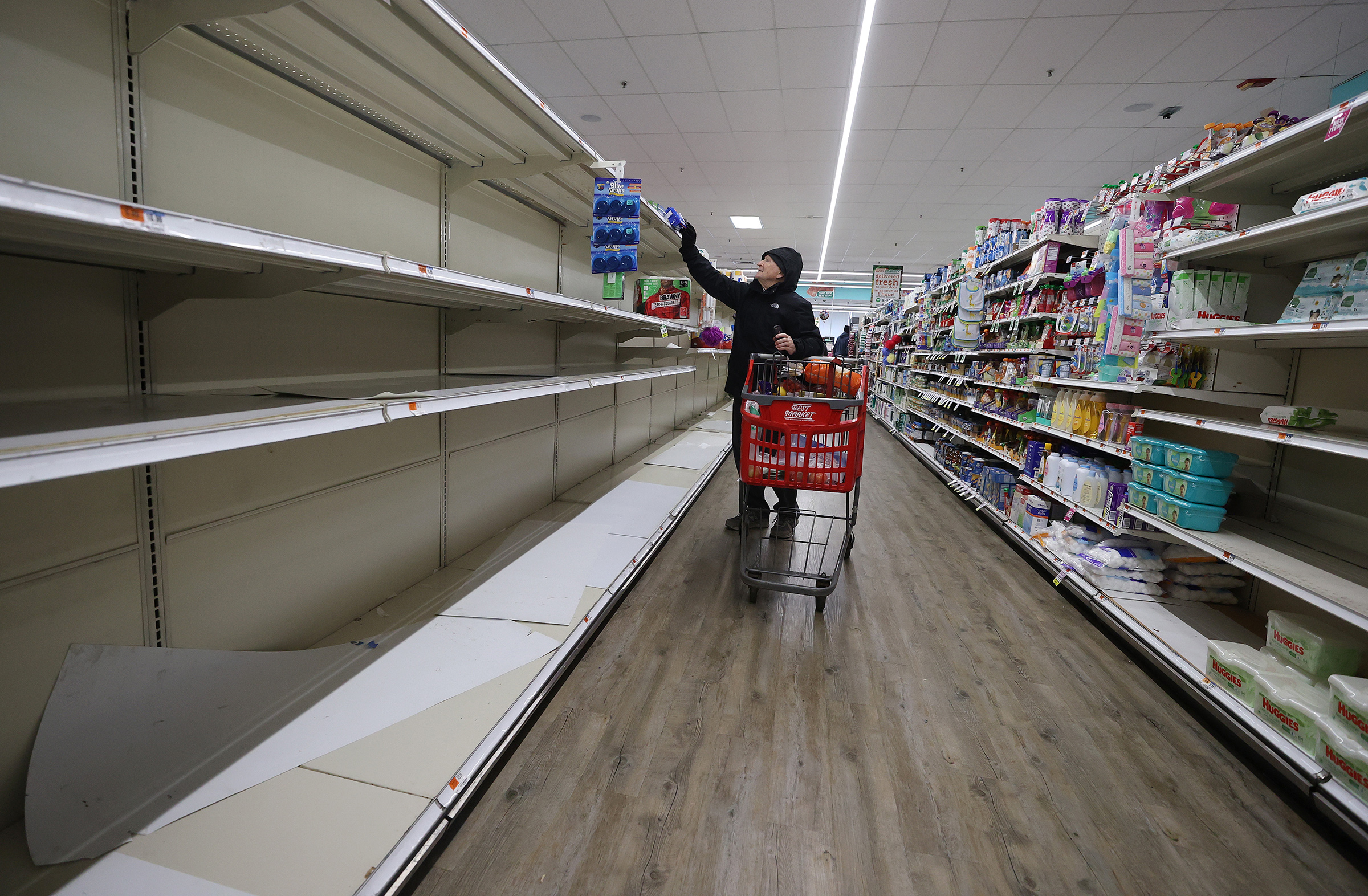 As the coronavirus continues to spread across the U.S., stores like Best Market face high demand for paper goods, leading to empty shelves on March 17 in Merrick, N.Y.