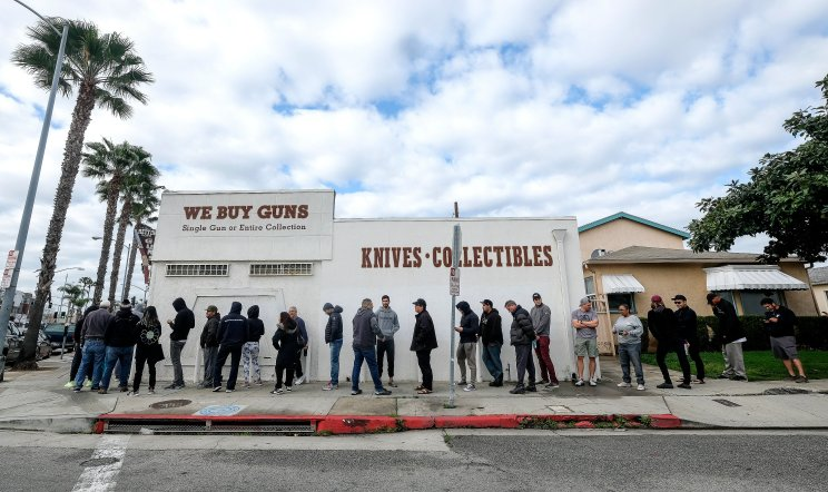 People wait in a line to enter a gun store in Culver City, Calif. on March 15, 2020. Coronavirus concerns have led to consumer panic buying of grocery staples, and now gun stores are seeing a similar run on weapons and ammunition as panic intensifies.