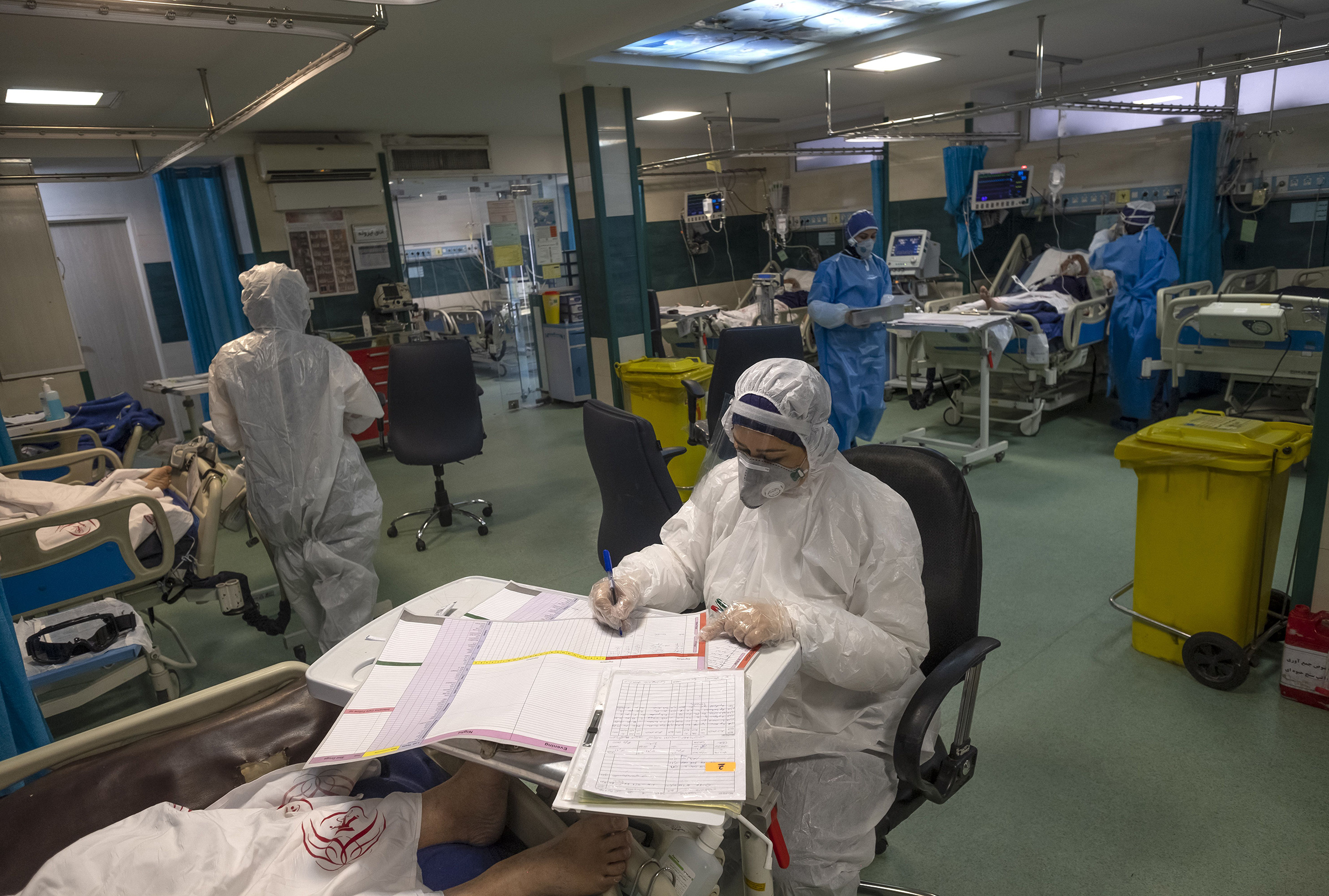 An Iranian medical personnel wearing protective gear works at a quarantine section of the Rassolakram hospital in western Tehran following a new coronavirus outbreak in Iran on March 11.