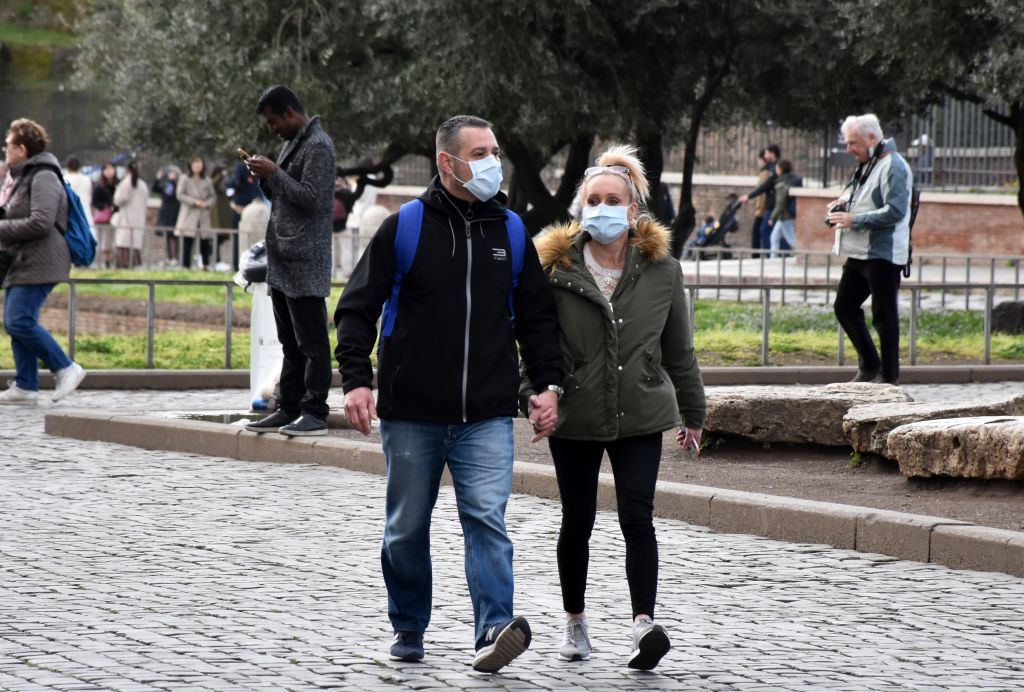 People wear face masks as a precaution against coronavirus in Rome, Italy on March 6, 2020.